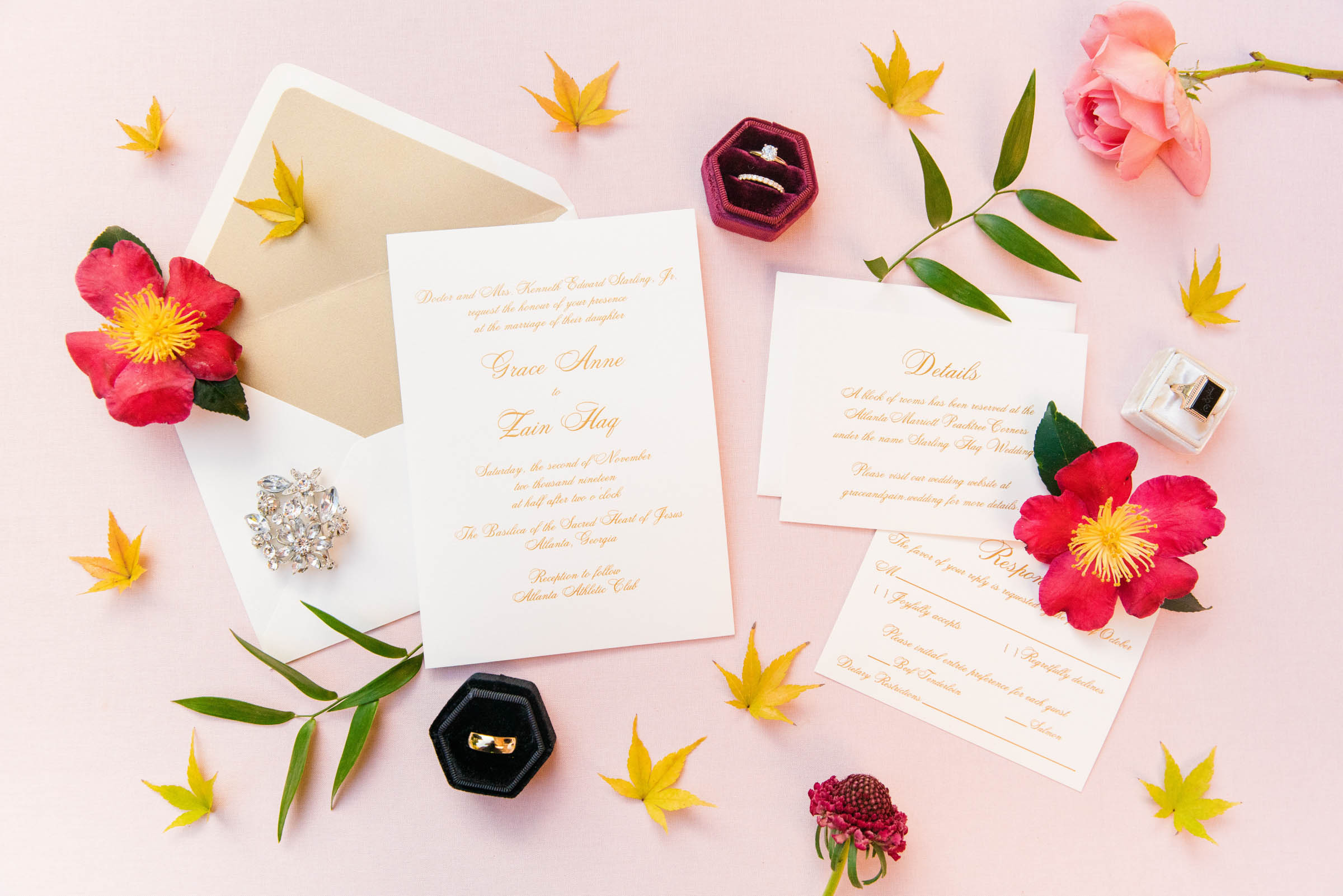 Flatlay with stationery and rings - photo by Dana Cubbage Weddings