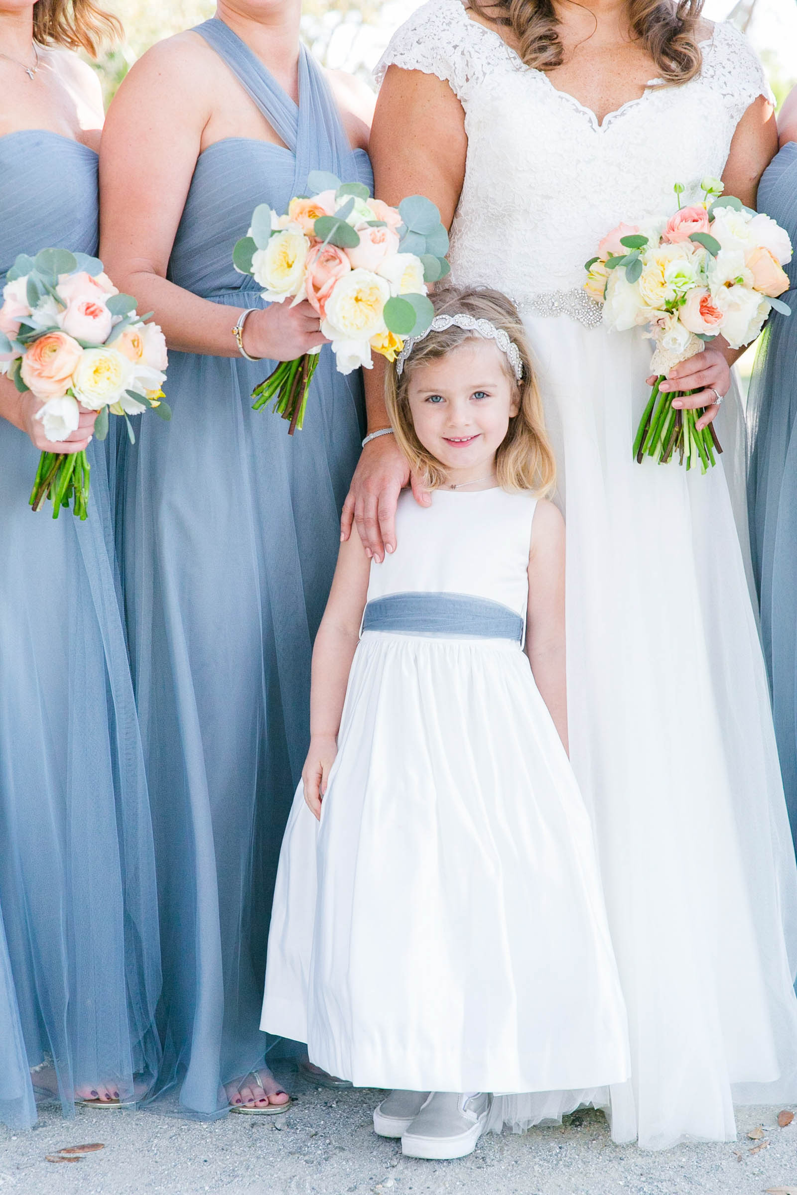 Flower girl portrait against bridal party - photo by Dana Cubbage Weddings