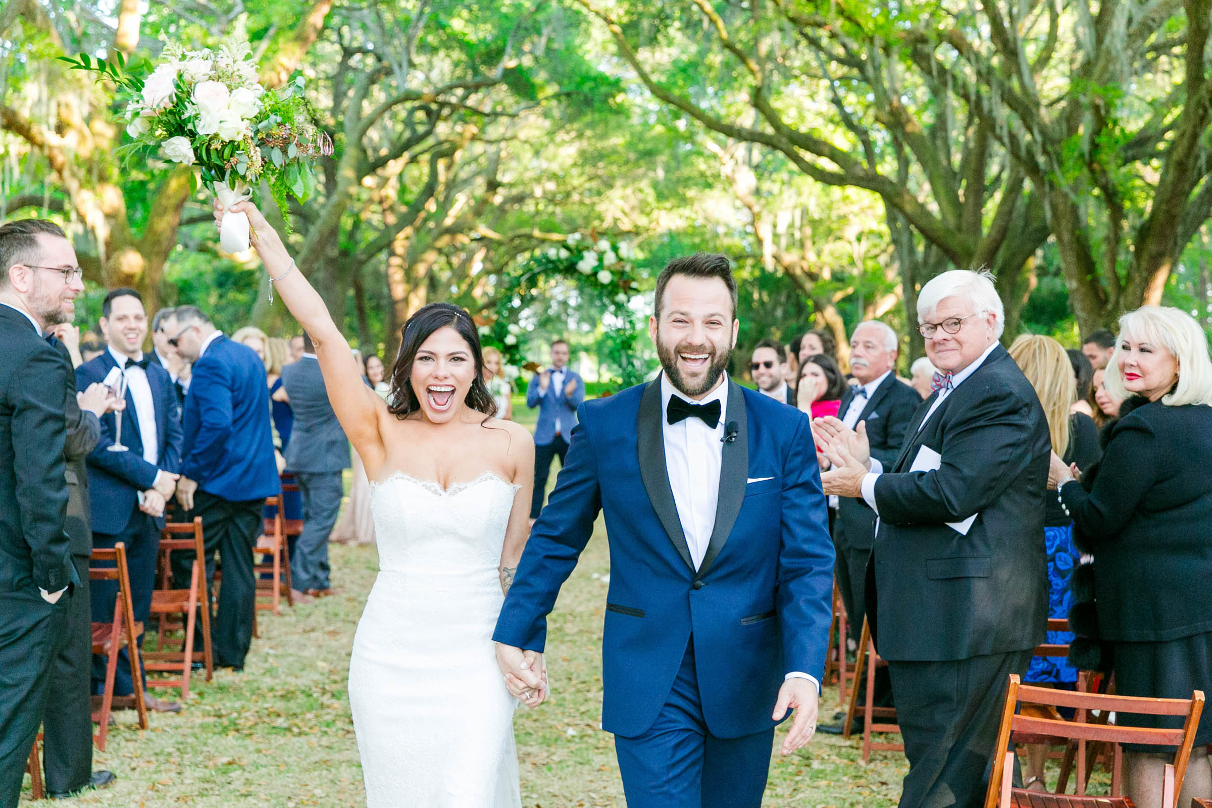 Happy couple outdoor recessional - photo by Dana Cubbage Weddings