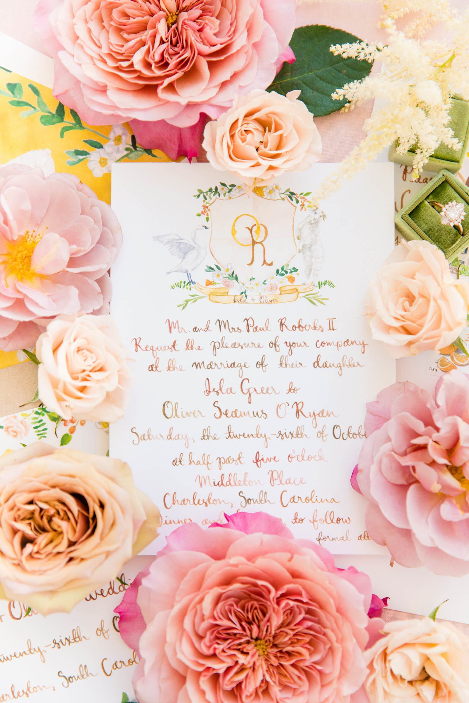 invitation amidst roses - photo by Dana Cubbage Weddings