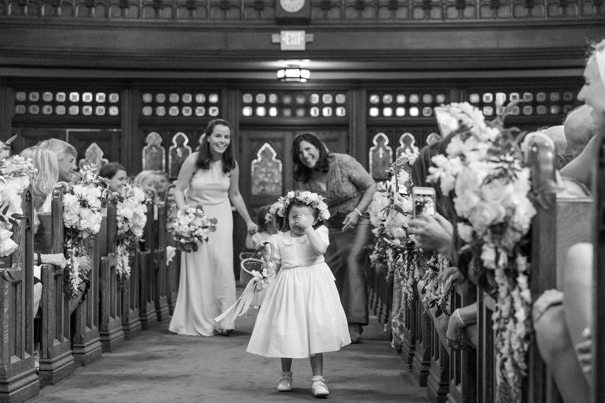 Sweet flower girl hides her face walking down aisle - photo by Dana Cubbage Weddings