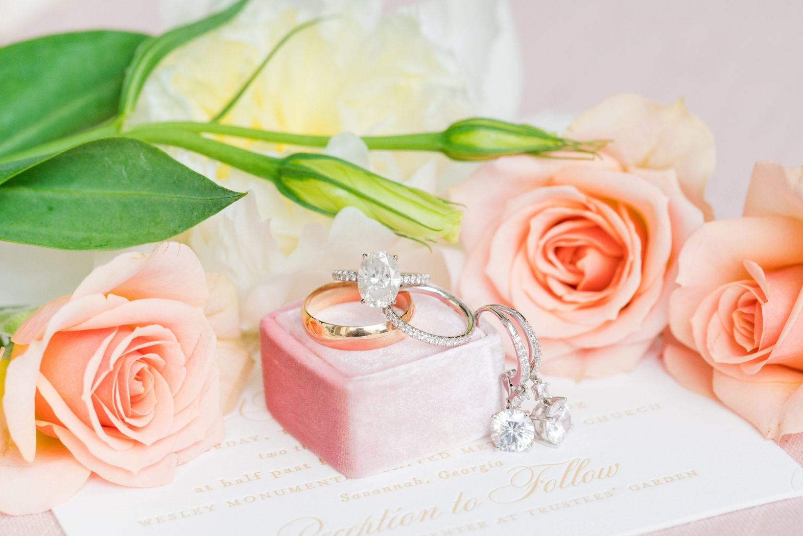 Gold and diamond rings and earrings with pale orange roses  - photo by Dana Cubbage Weddings