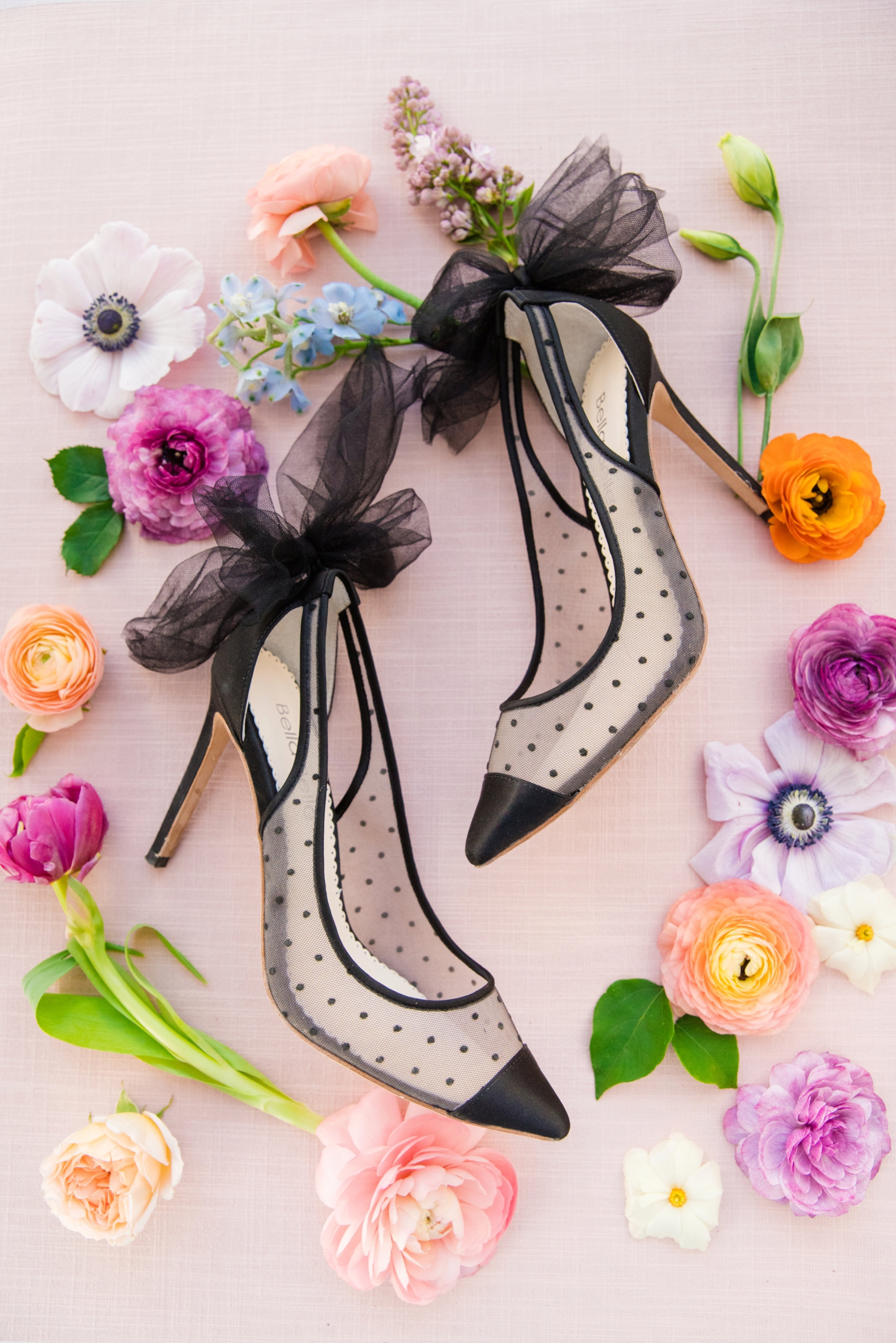 spring flowers and ribboned slingback pumps with polka dots - photo by Dana Cubbage Weddings