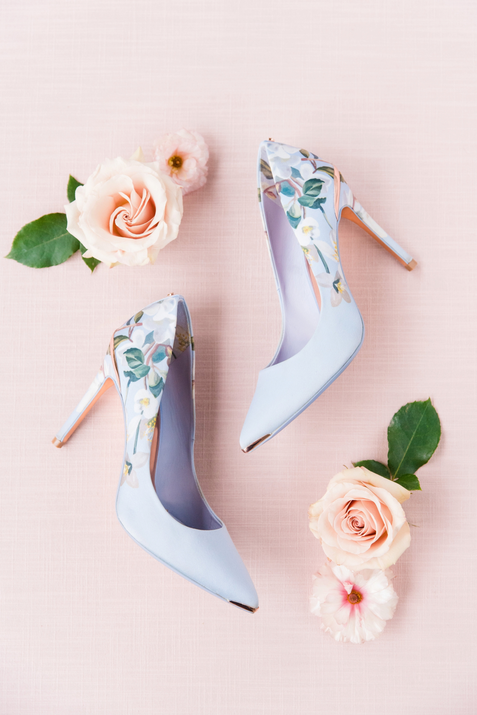 Styled shoot lavender floral heels in floral display - photo by Dana Cubbage Weddings