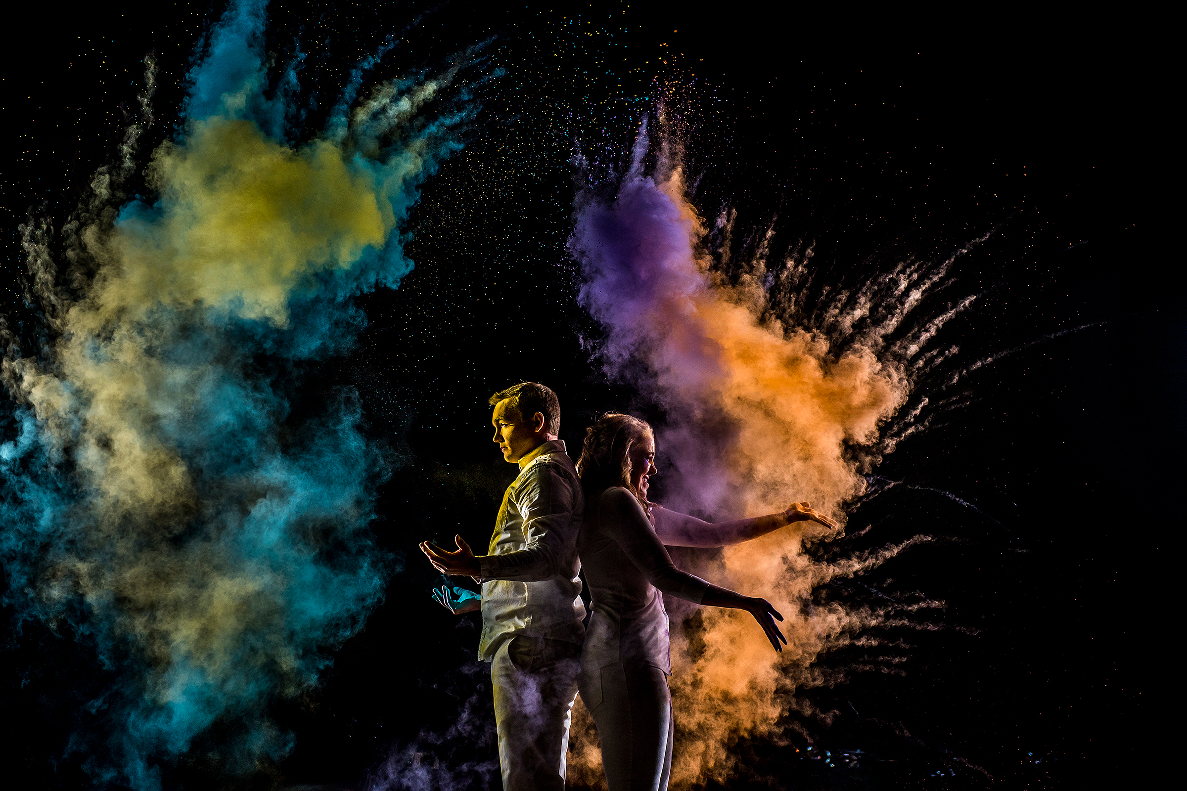 Back to back couple with colored smoke bombs - photo by J La Plante Photo