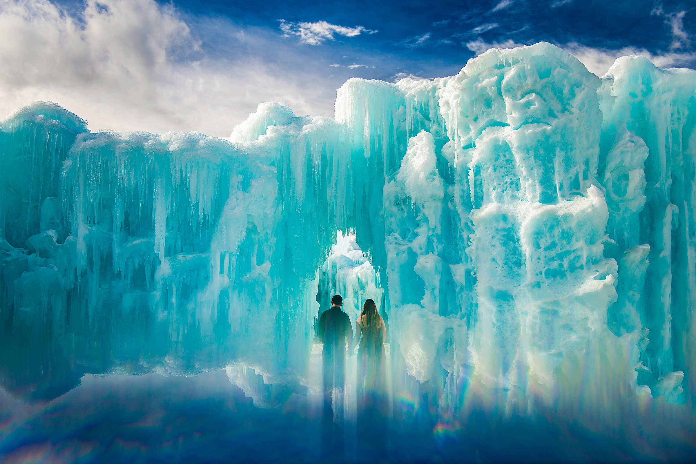 Bride and groom against ice cliffs - photo by J. La Plante Photo