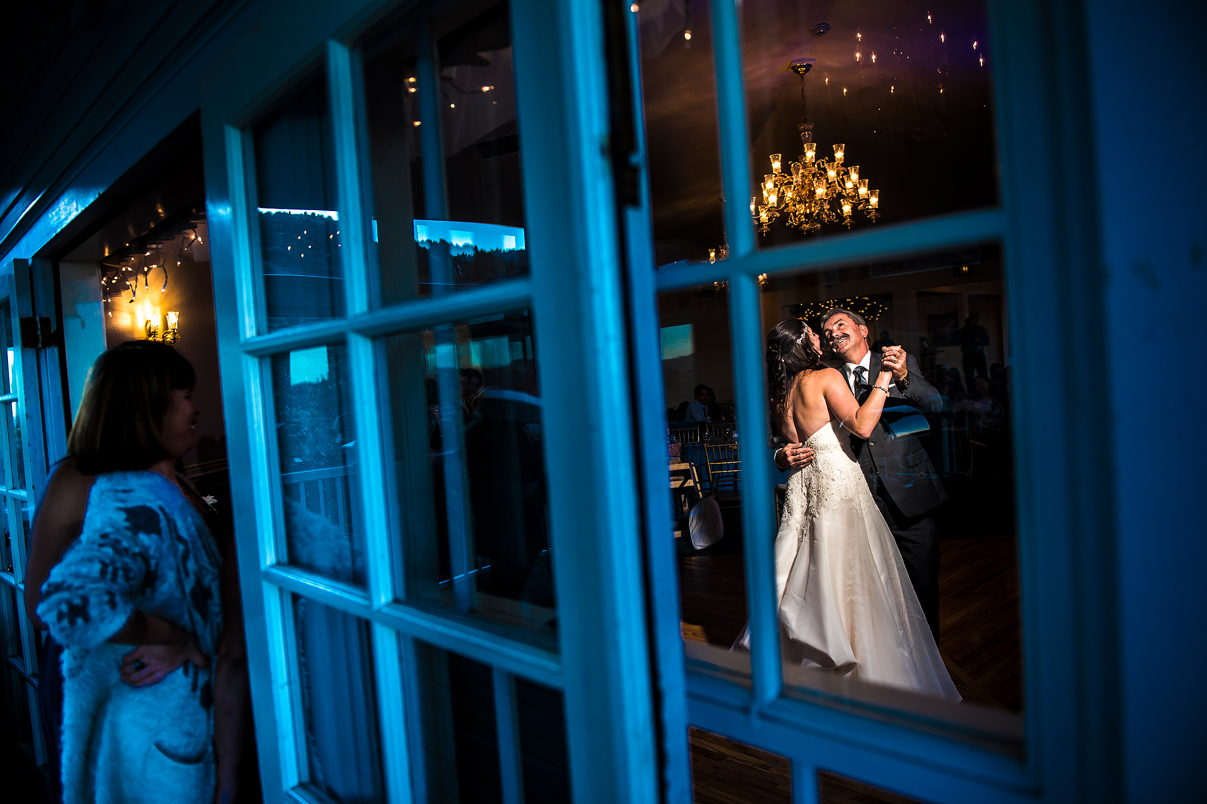 Creative composition father daughter dance through window - photo by J La Plante Photo
