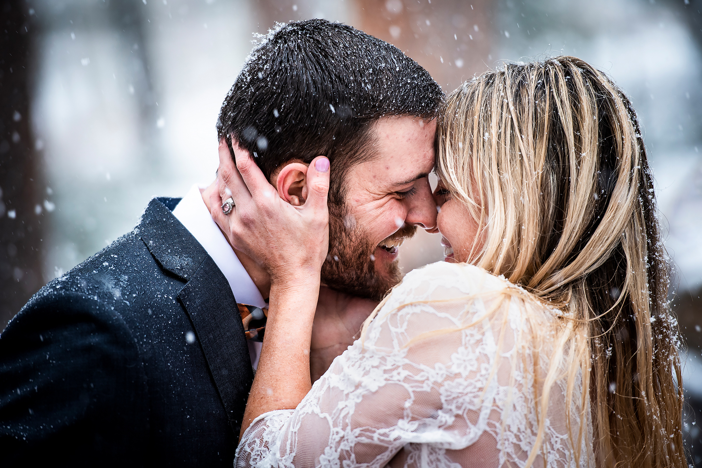Face to face couple in falling snow - photo by J La Plante Photo