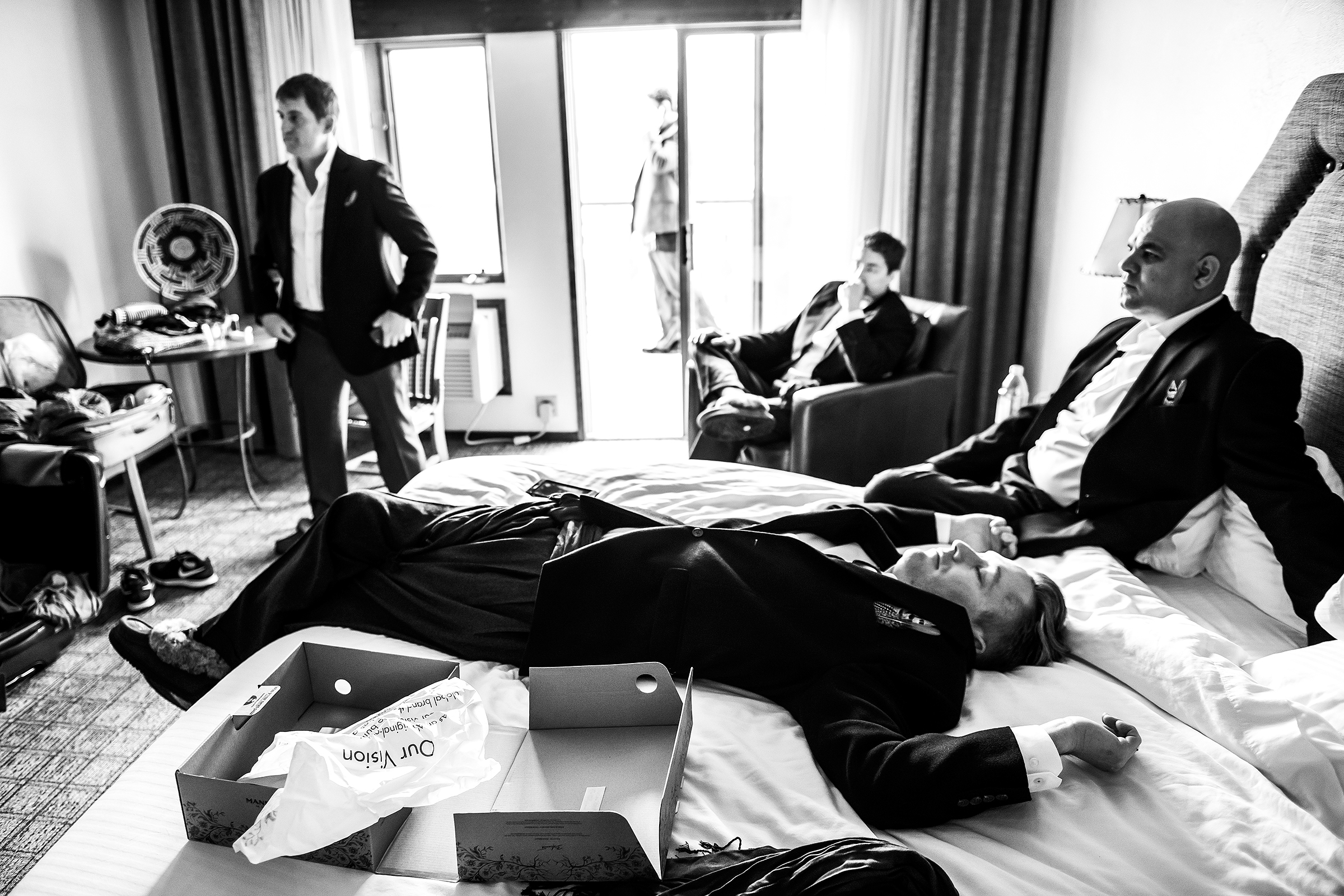 Groom and groomsmen hanging out in room - photo by J. La Plante Photo