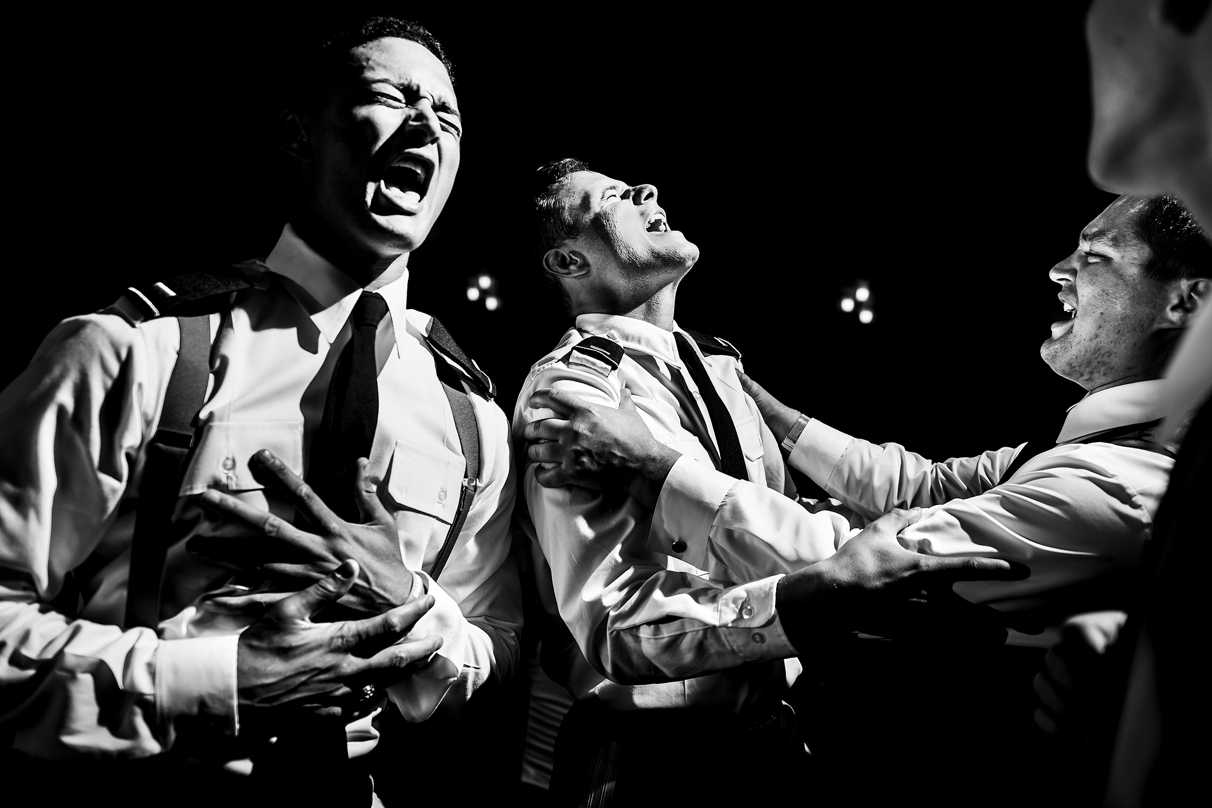 Grooms singing and partying - photo by J. La Plante Photo