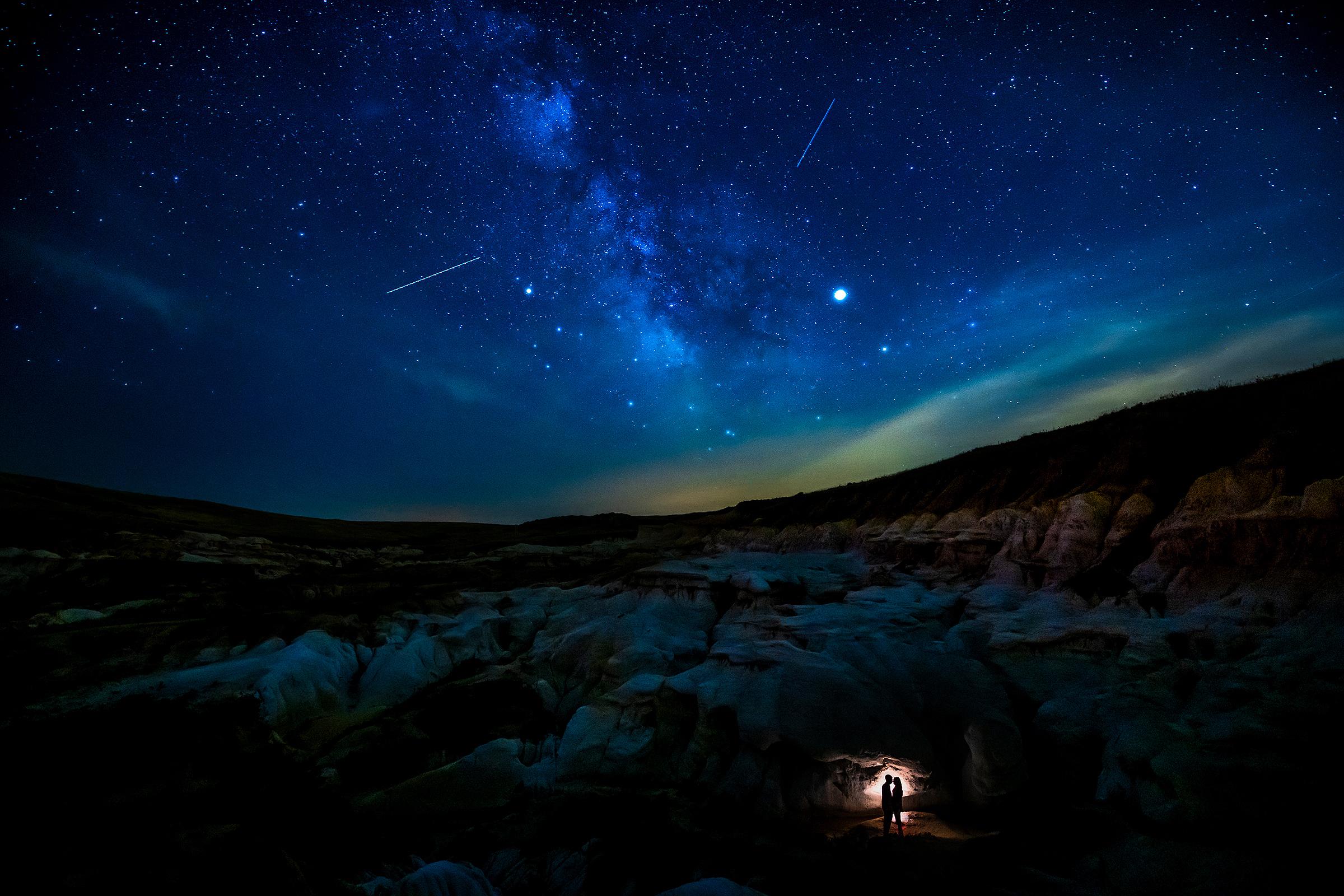 Northern lights couple silhouette - photo by J La Plante Photo
