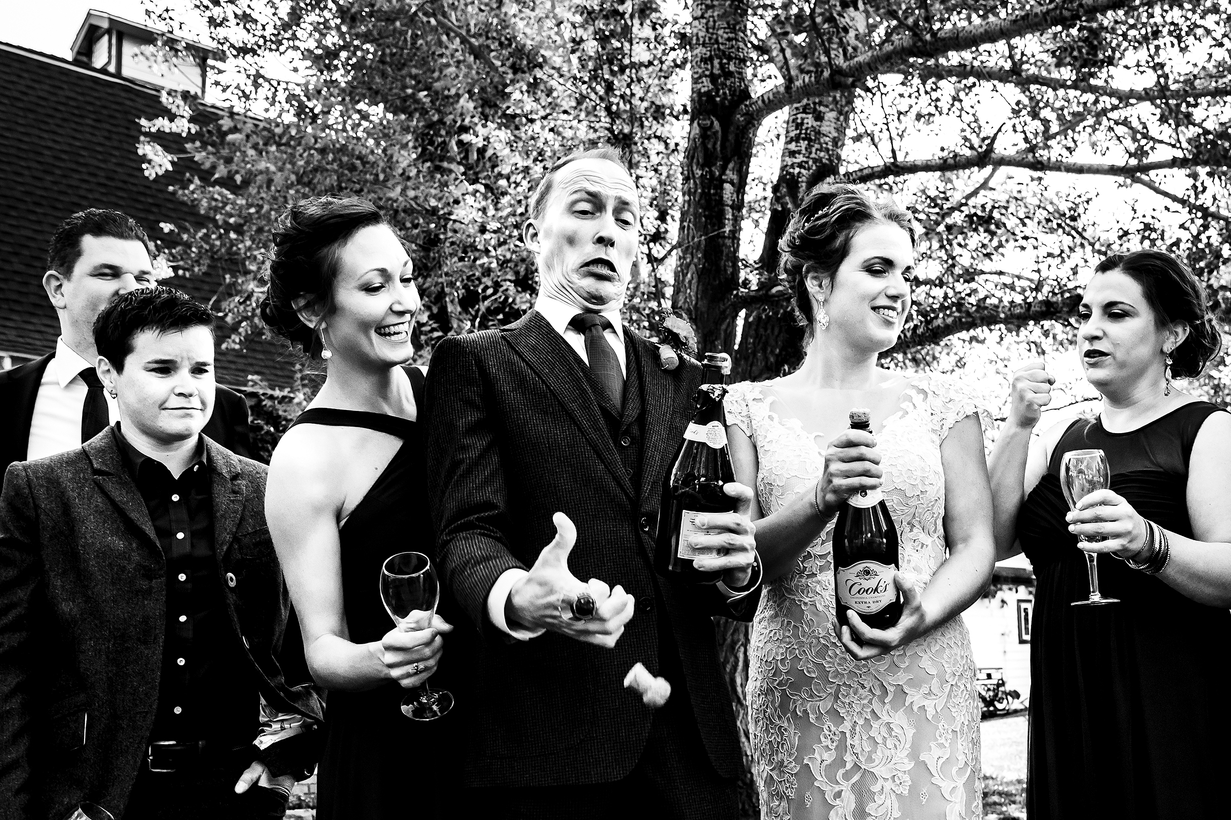 Opening up the bubbly - photo by J La Plante Photo