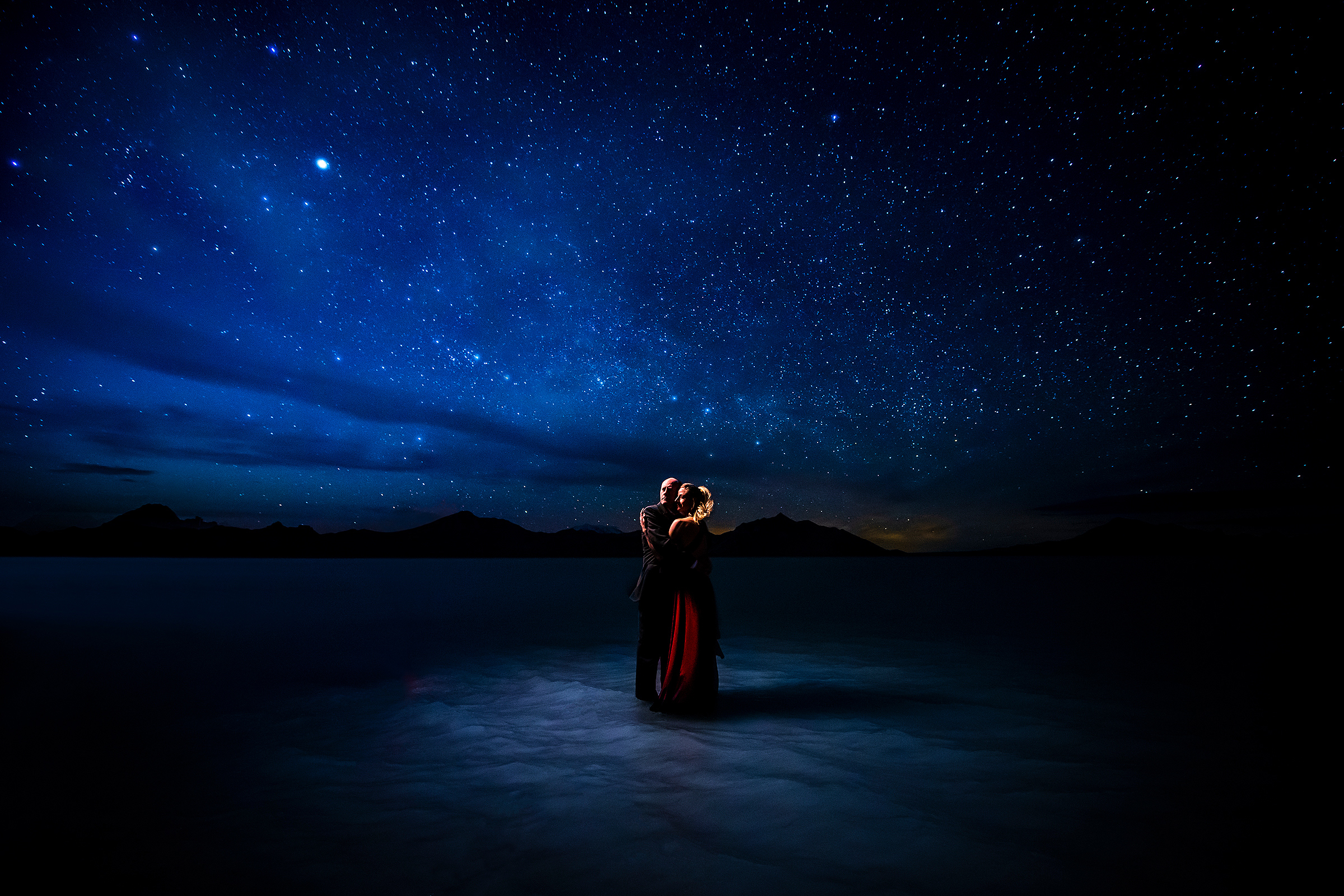 Partial silhouette against northern lights - photo by J La Plante Photo