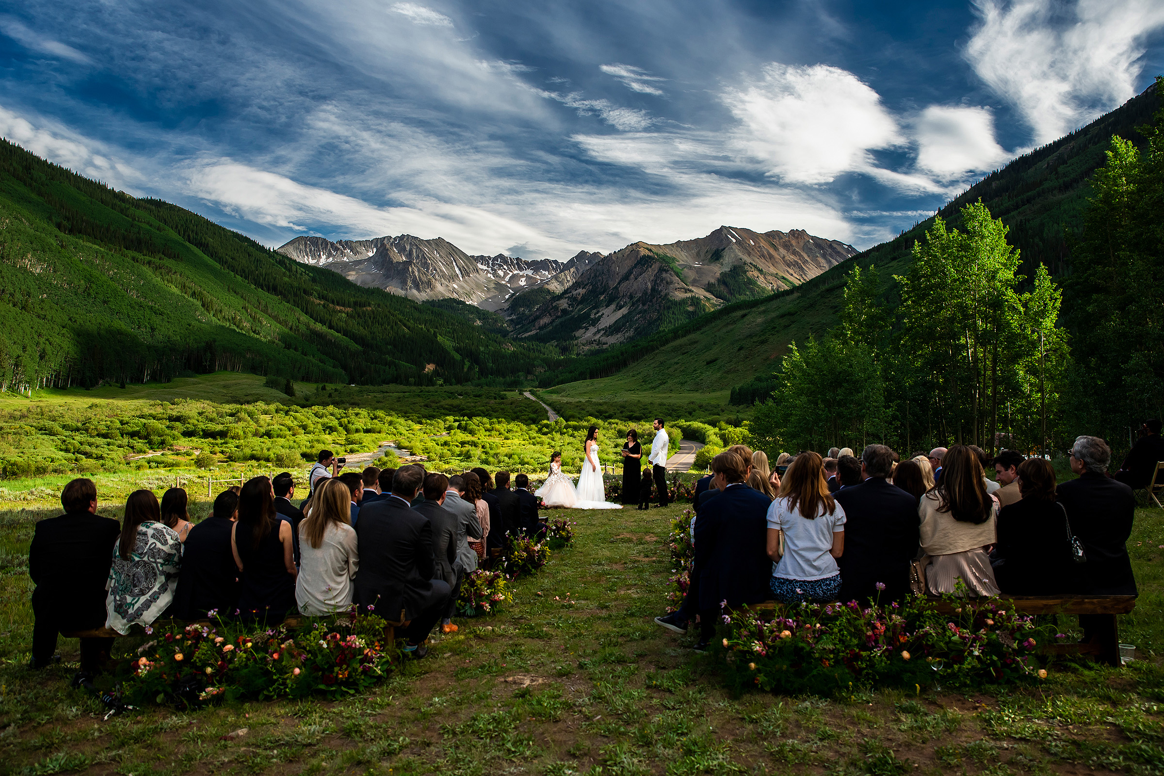 Wedding ceremony against mountains in Colorado's Pine Creek Cookhouse - photo by J. La Plante Photo