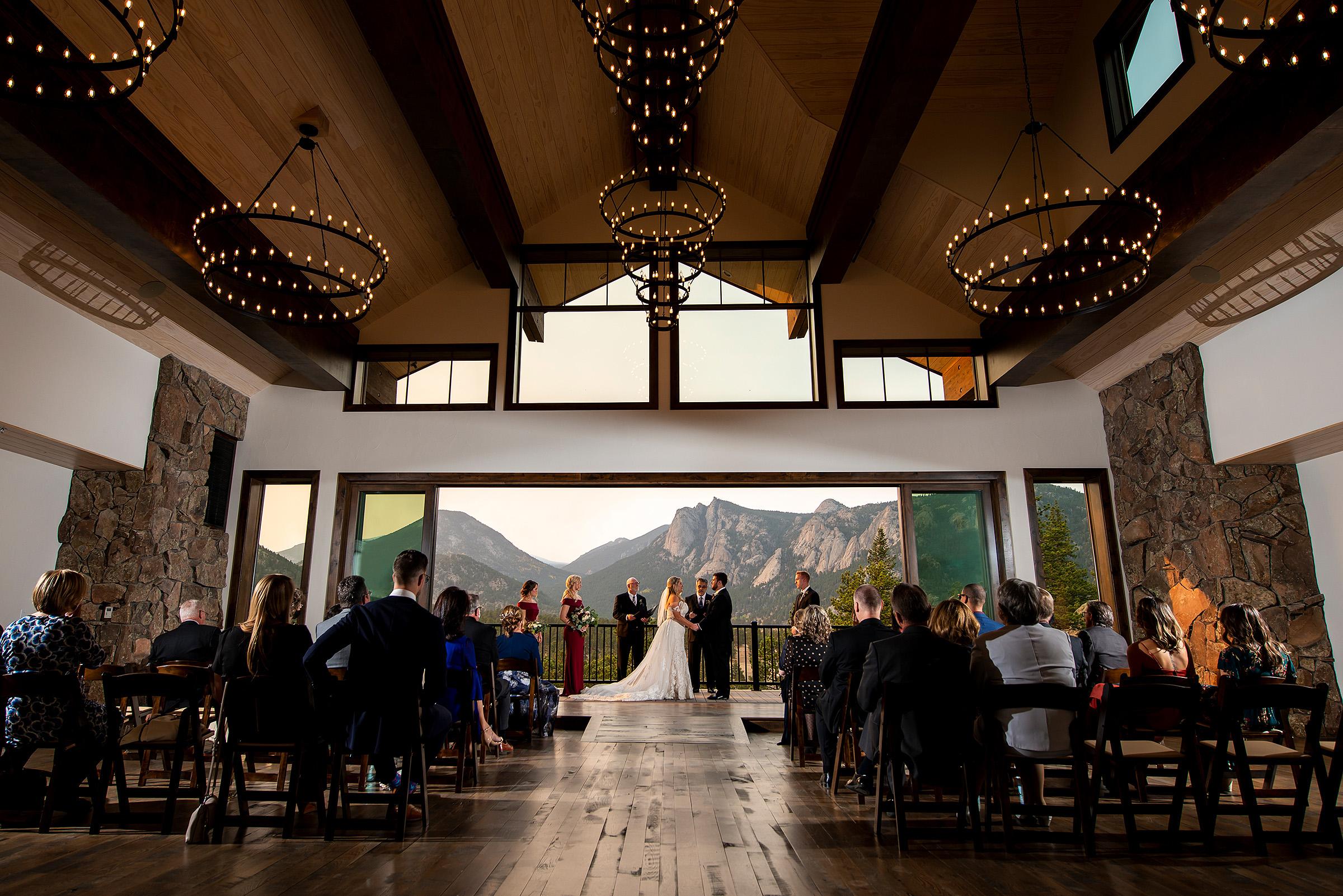 Ceremony against mountain backdrop - photo by J. La Plante Photo