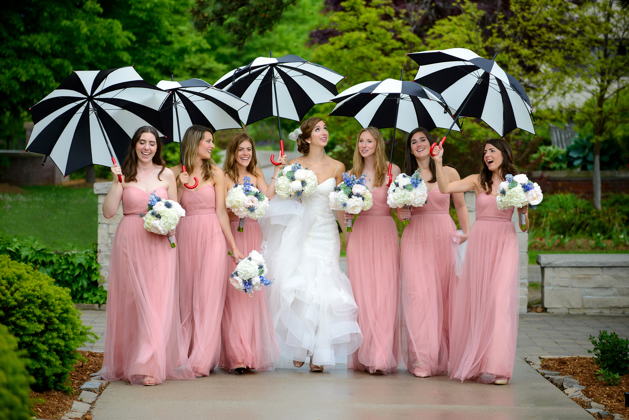 Bridal party with black and white umbrellas - photo by Storey Wilkins Photography