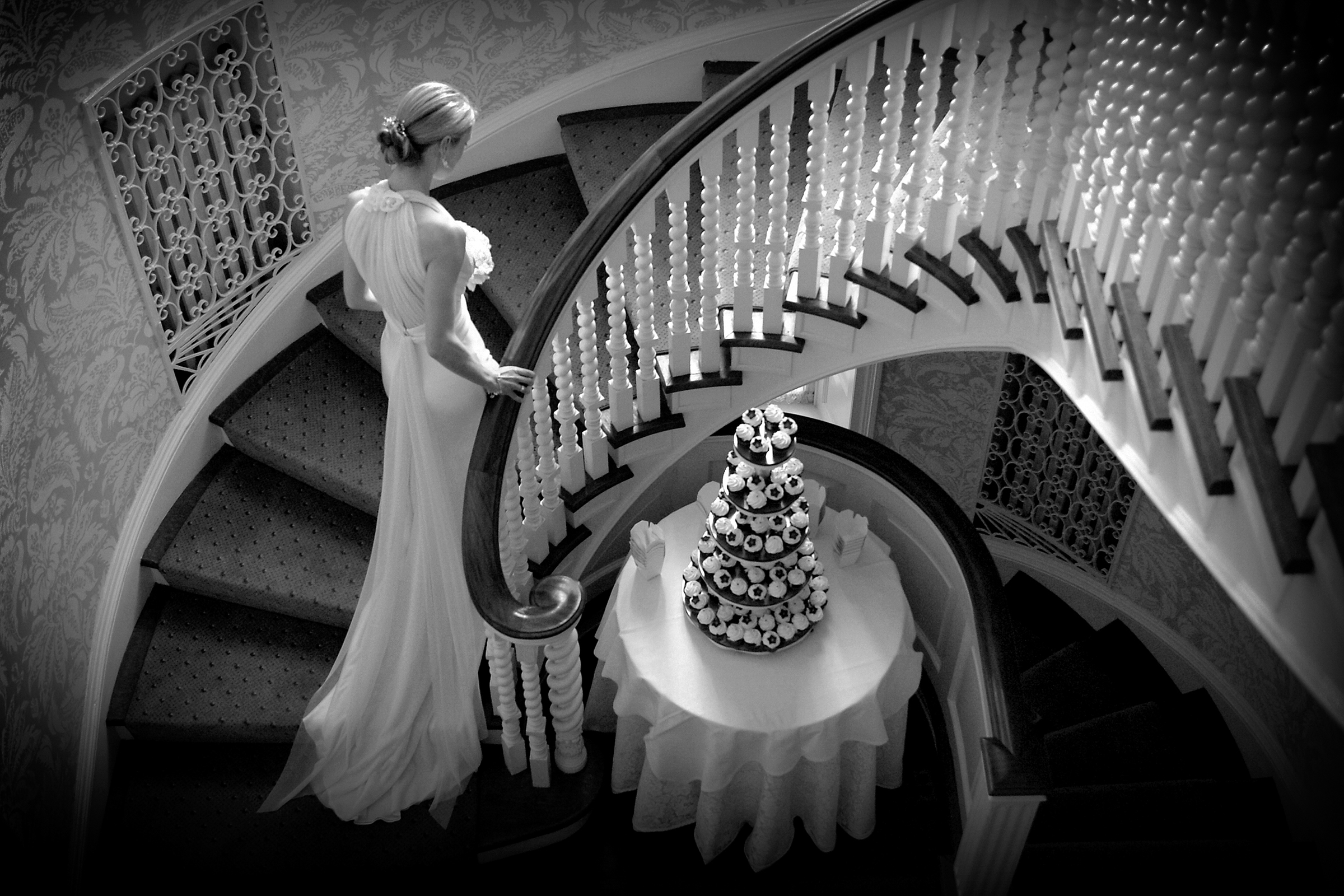 Bride ascending staircase - photo by Storey Wilkins Photography