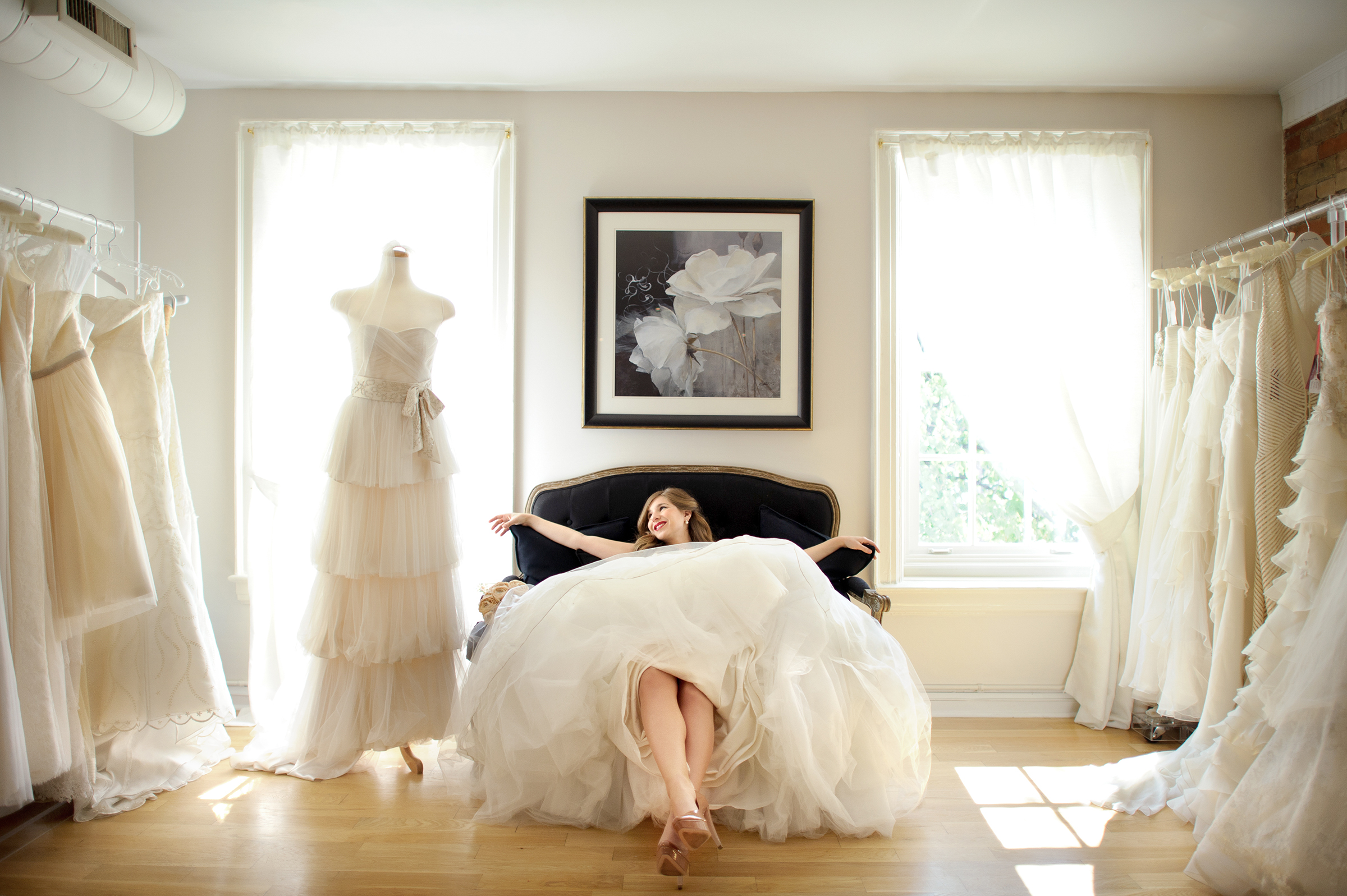 Bride lounges on love seat - photo by Storey Wilkins Photography
