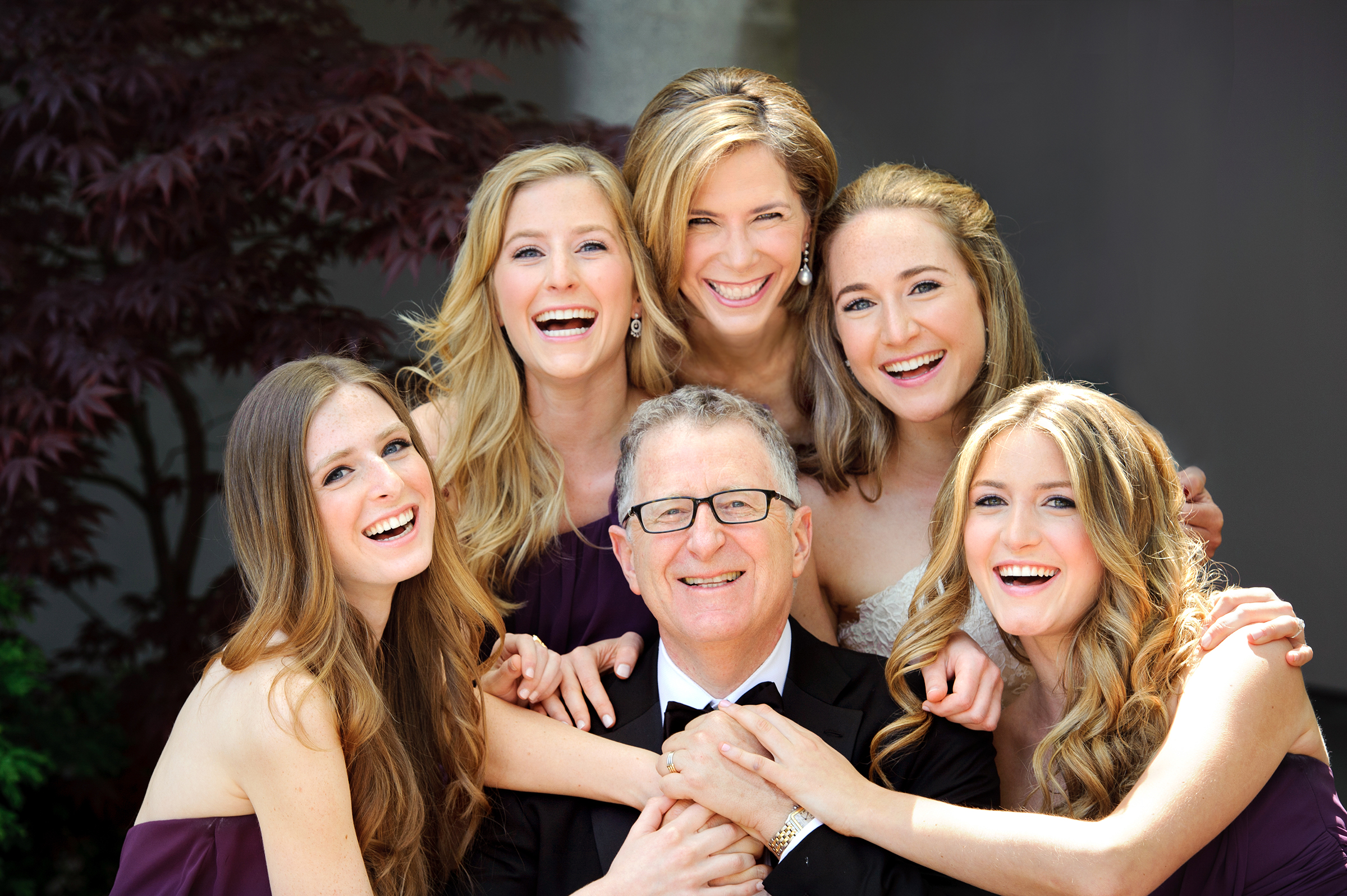 Bridesmaids surround father of the bride - photo by Storey Wilkins Photography