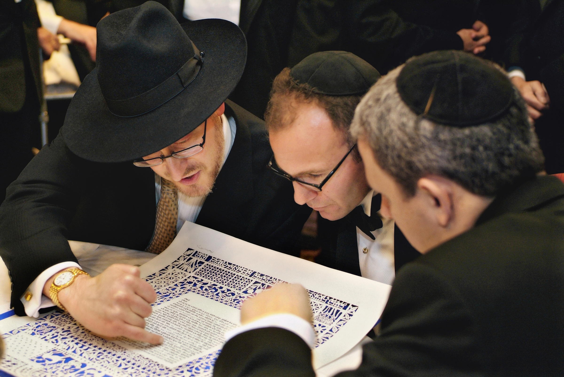 reading the ketubah - photo by Storey Wilkins Photography