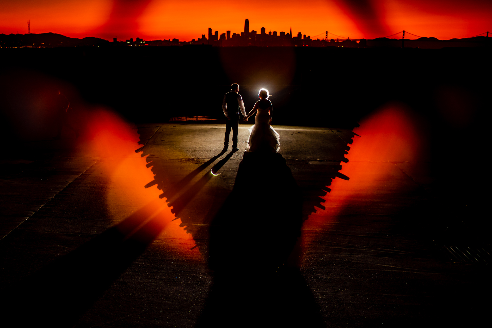 backlit silhouette creative portrait of bride and groom- photo by Chrisman Studios