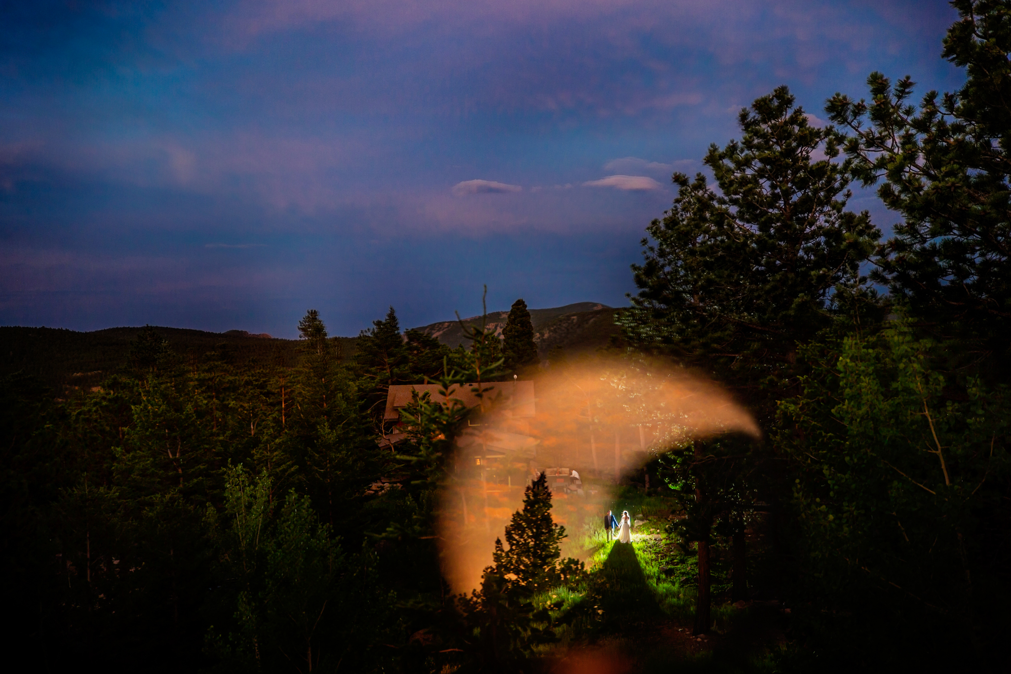 bride and groom landscape portrait with dark shadows- photo by Chrisman Studios