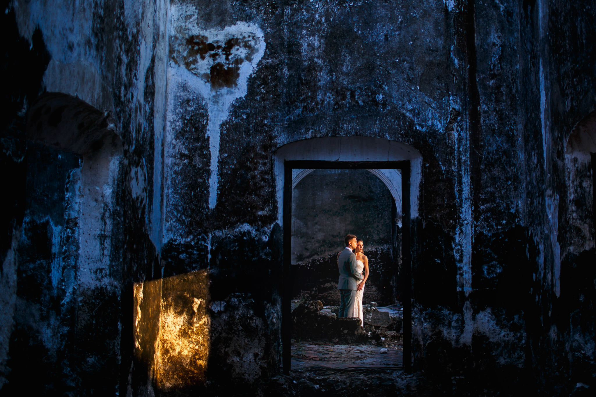 bride and groom portrait in a old cave like building- photo by Chrisman Studios
