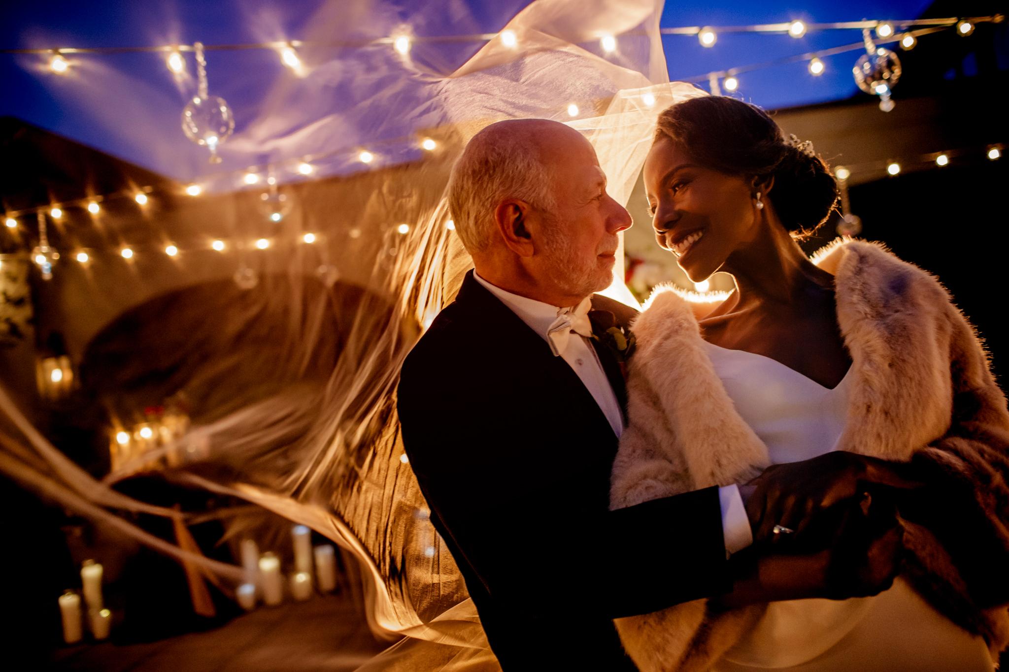 bride and groom romantic candlelit portrait- photo by Chrisman Studios