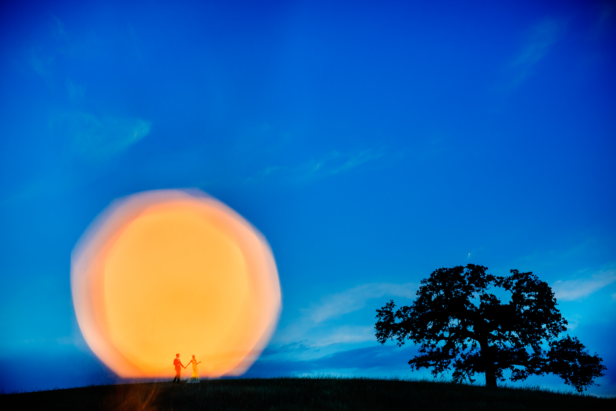 couple in a creative landscape portrait silhouetted- photo by Chrisman Studios