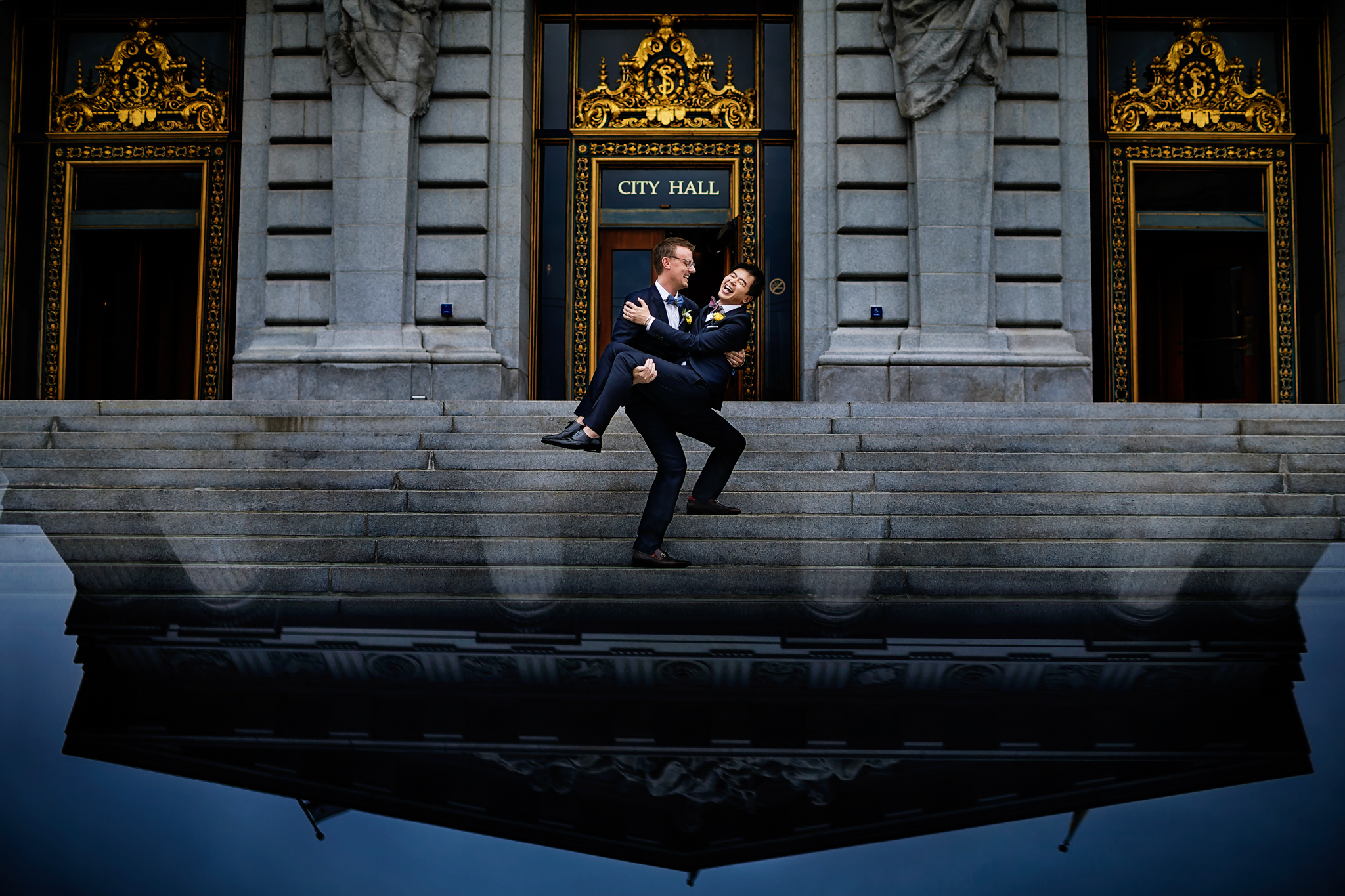 happy grooms just married at city hall- photo by Chrisman Studios
