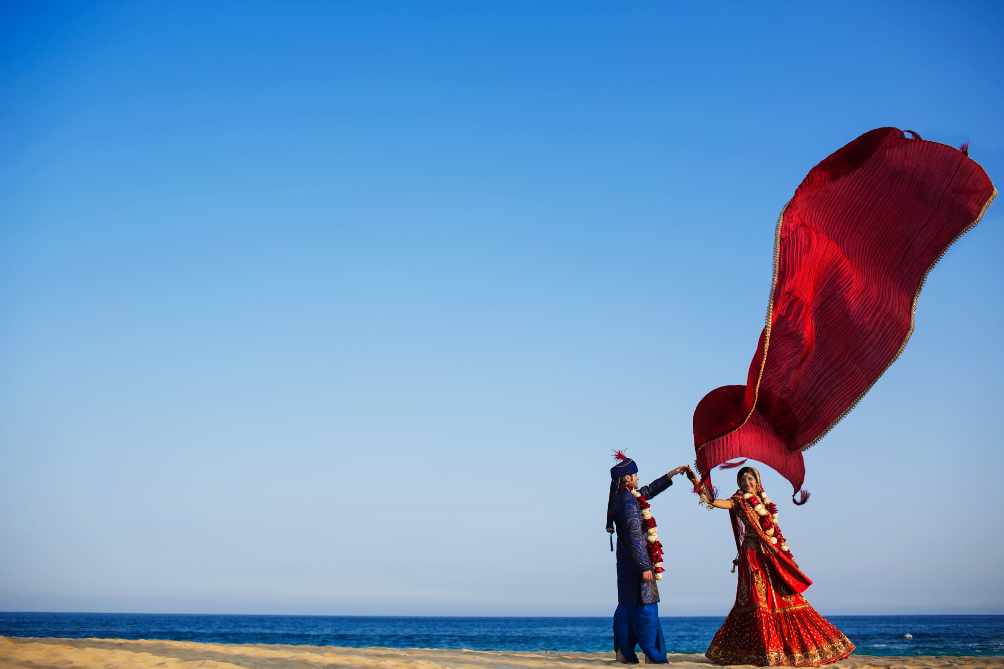 indian bride and groom in a fun romantic moment- photo by Chrisman Studios