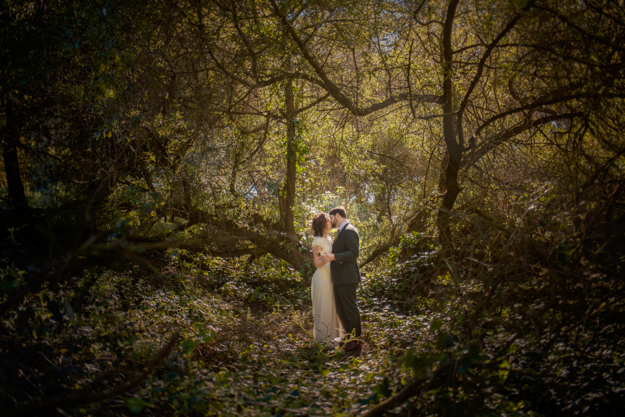 romantic bride and groom moment  in forest- photo by Chrisman Studios