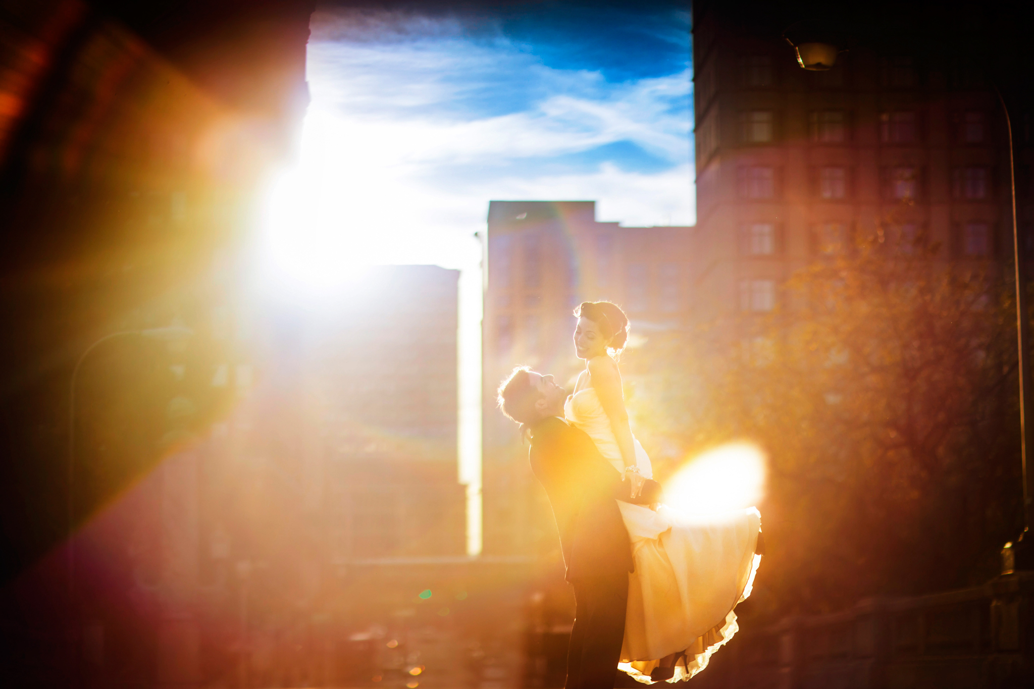 whimsical bride and groom moment sun flare- photo by Chrisman Studios