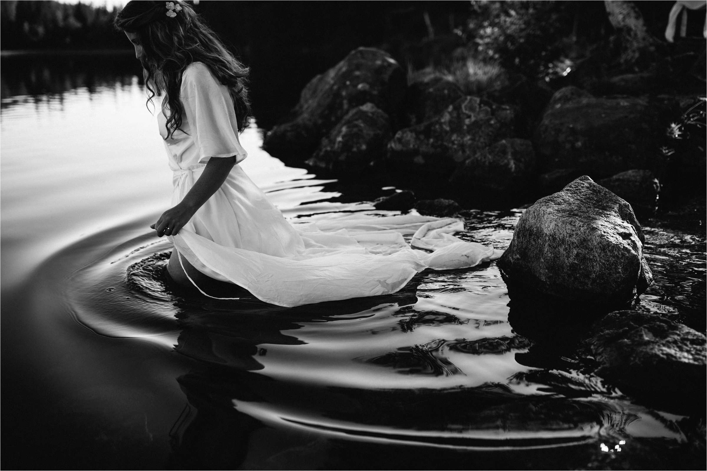Bride wading in water - photo by The Crawleys