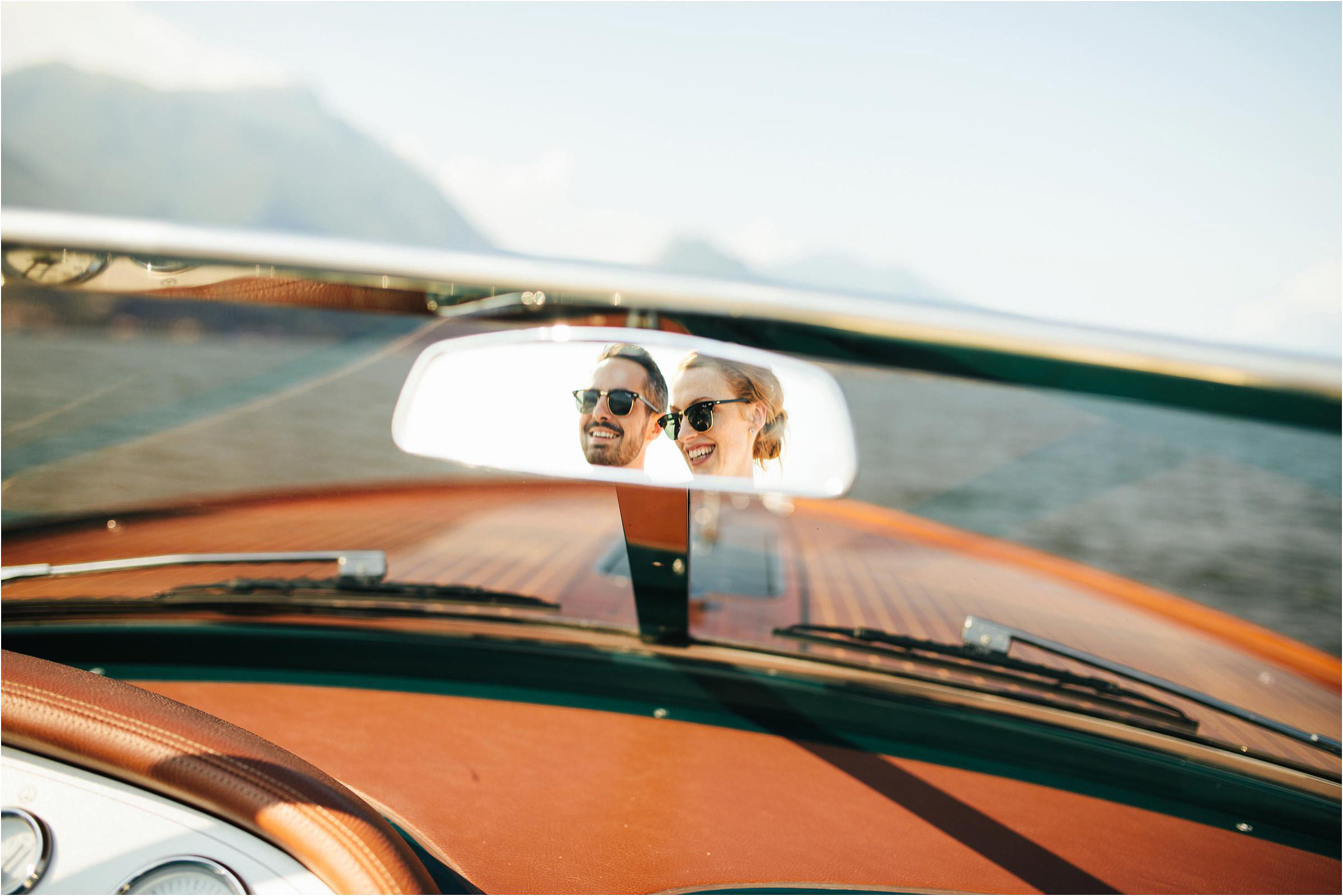 Creative composition of couple in rear view mirror - photo by The Crawleys