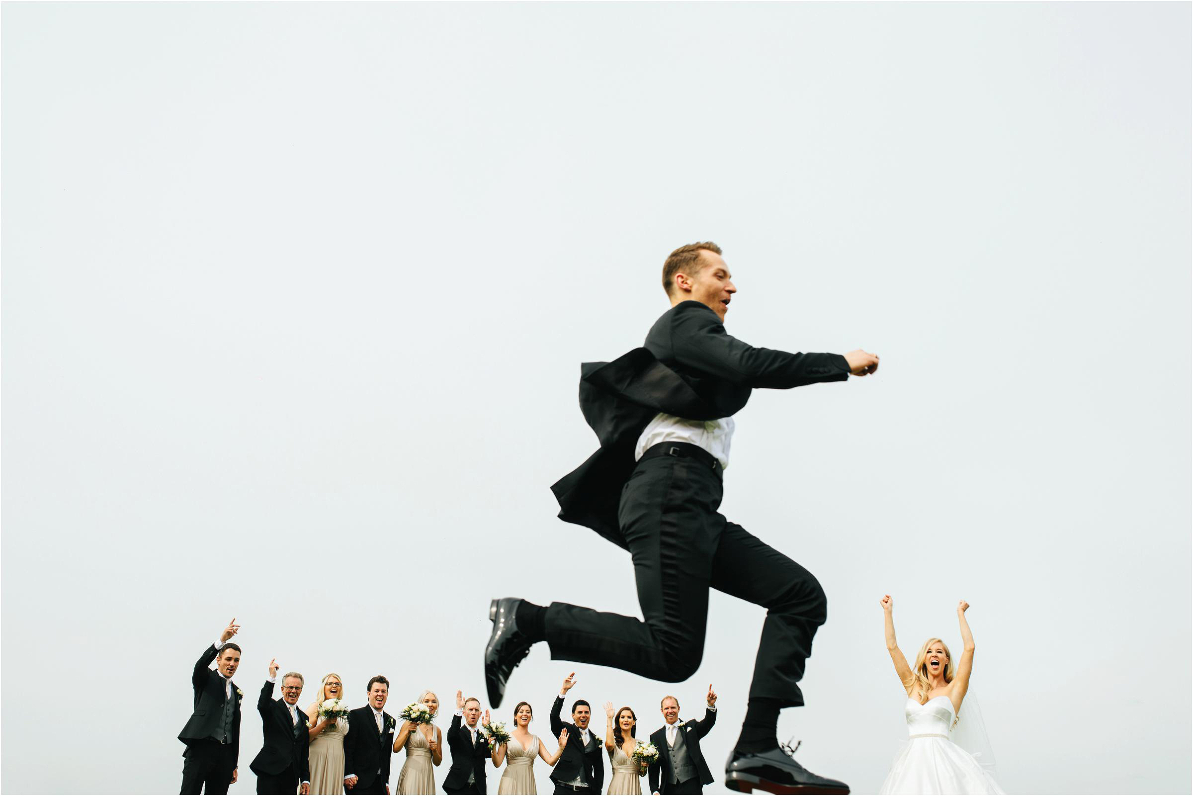Creative composition of groom running in air - photo by The Crawleys