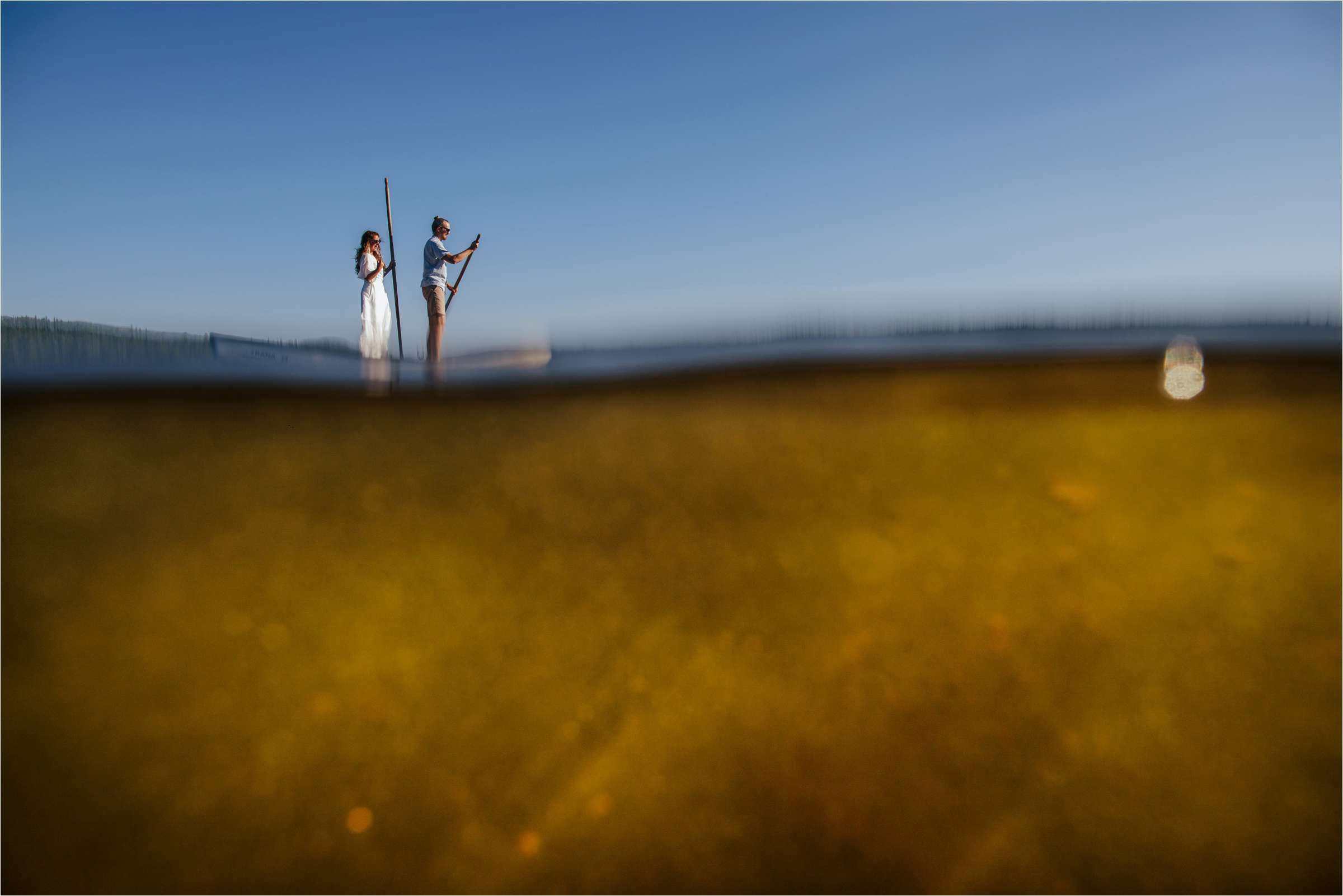 Painterly couple portrait paddle boarding - photo by The Crawleys