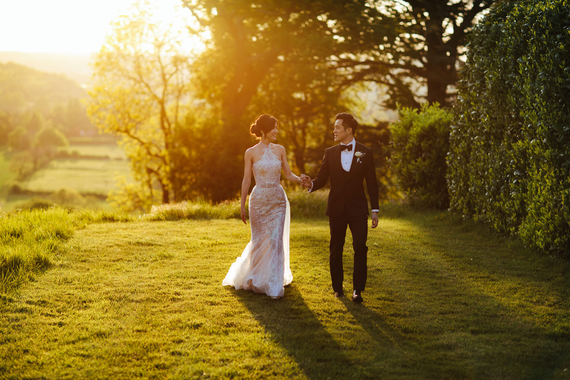 Couple in garden of Hedsor House - photo by The Crawleys