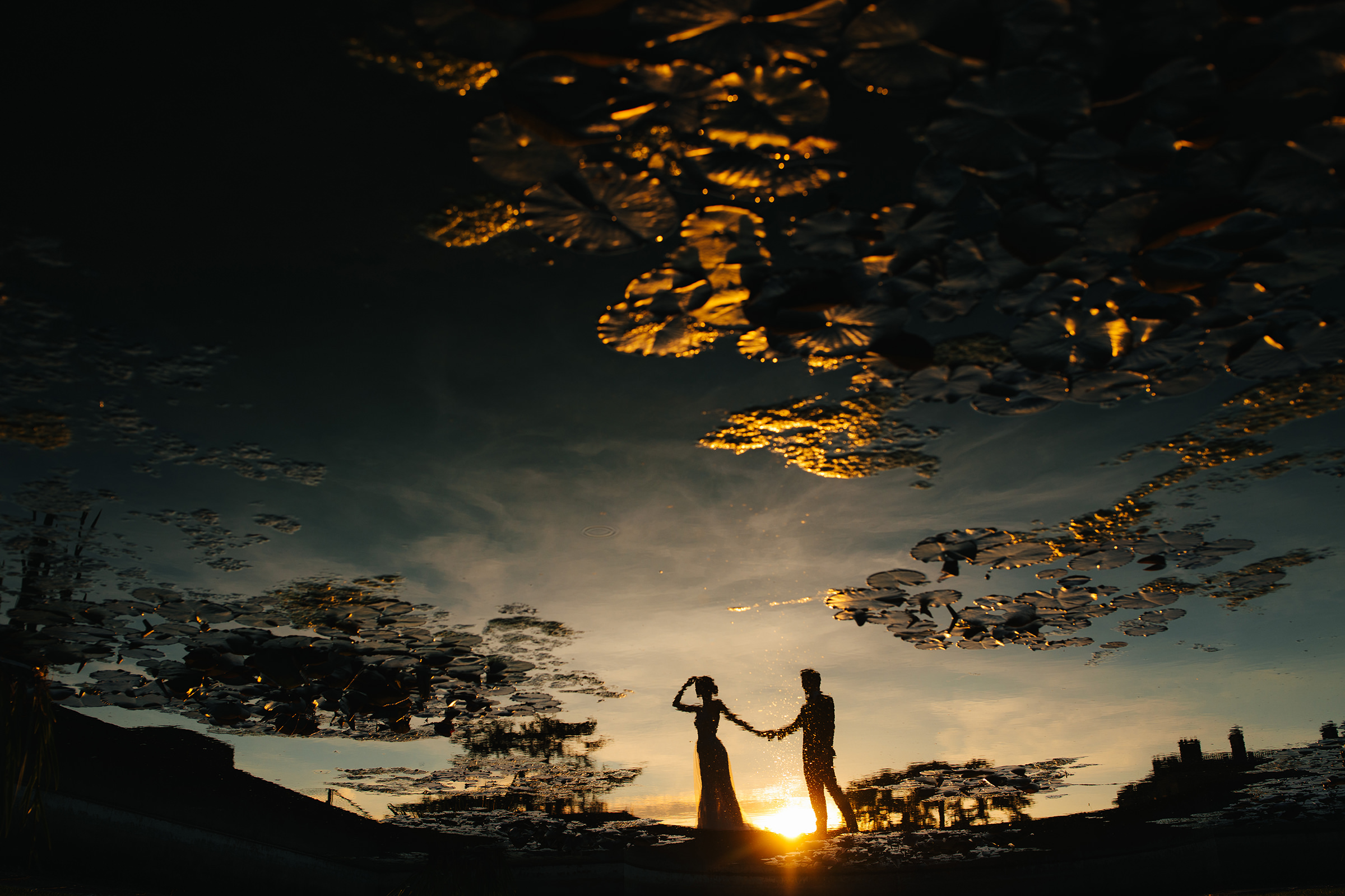 Couple silhouette with dramatic lighting reflected at Hedsor House Taplow UK - photo by The Crawleys