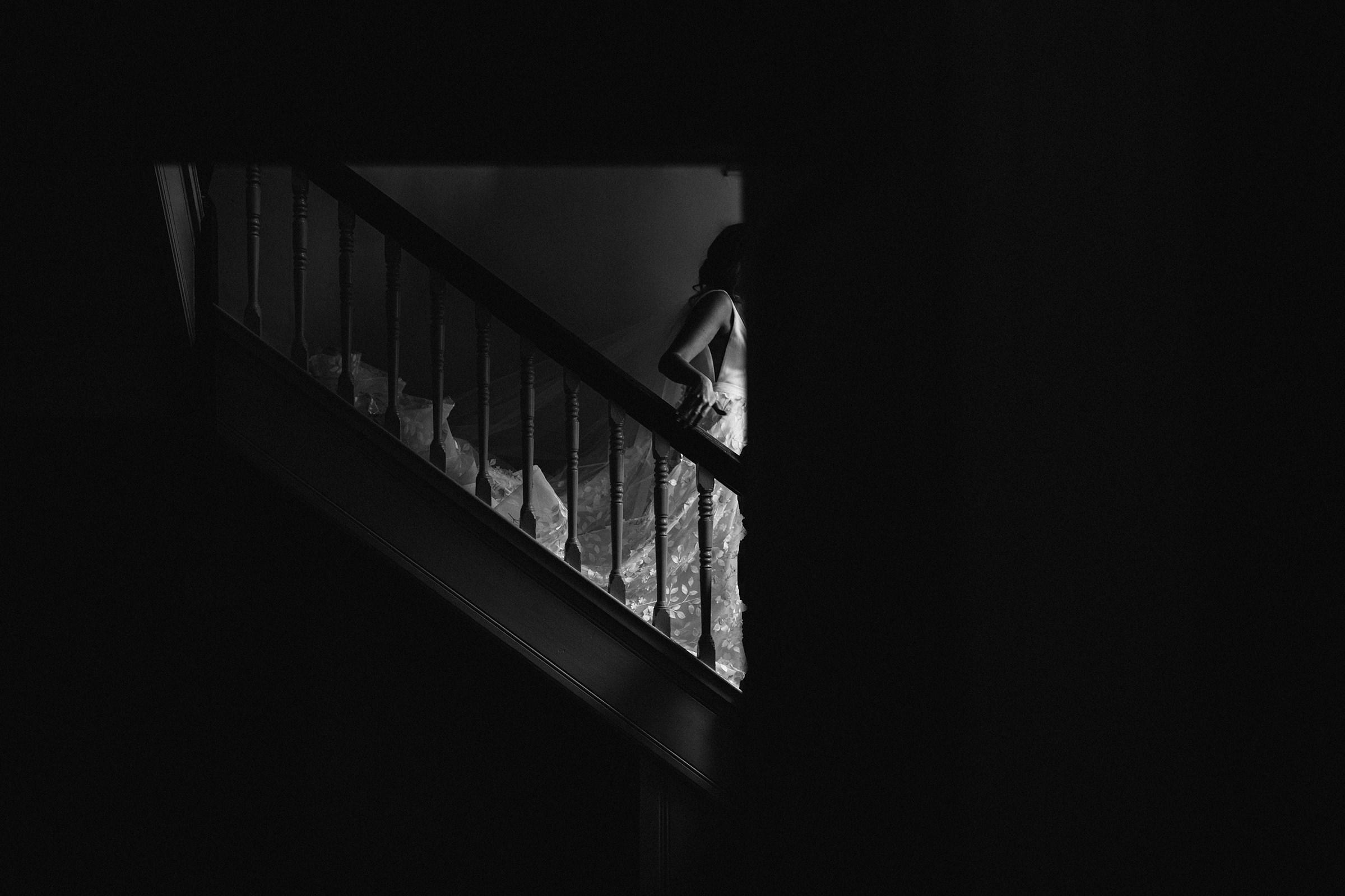 Creative composition of bride descending staircase - photo by The Crawleys