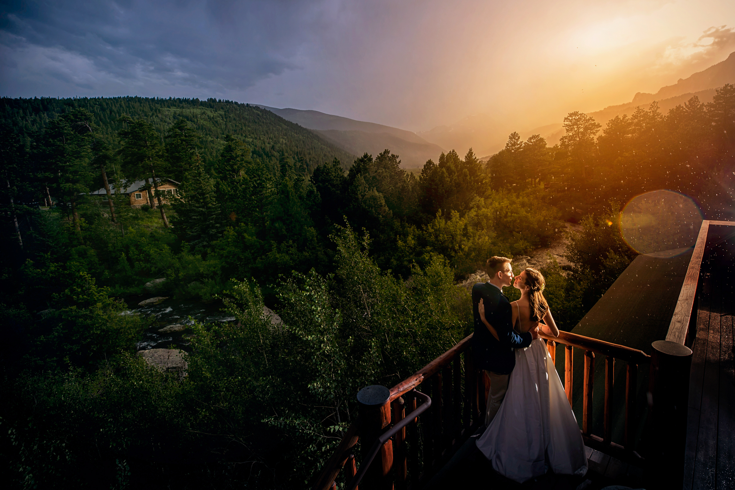Bride and groom during golden hour on balcony - photo by Chrisman Studios