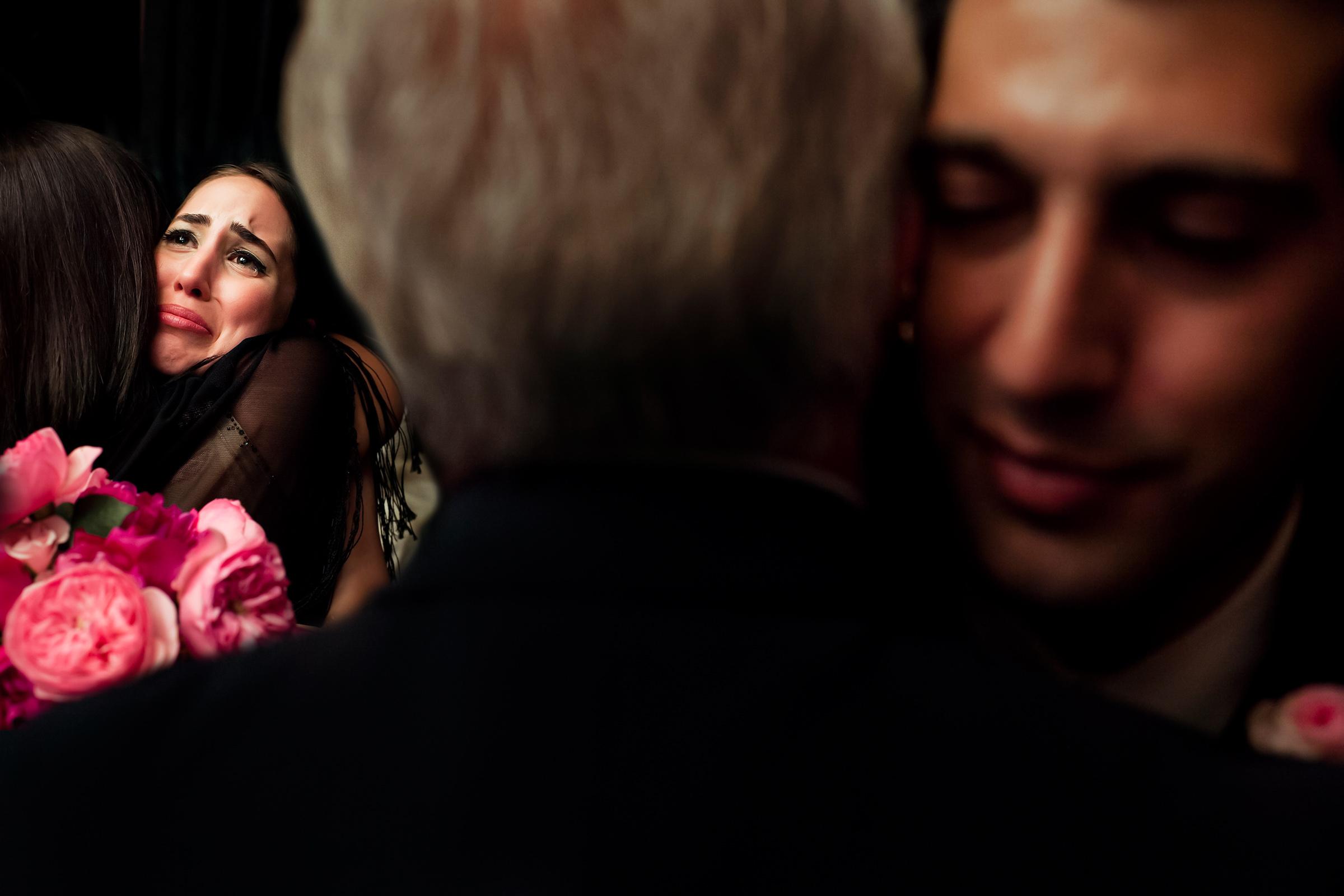 Bride and groom embrace parents - photo by Chrisman Studios