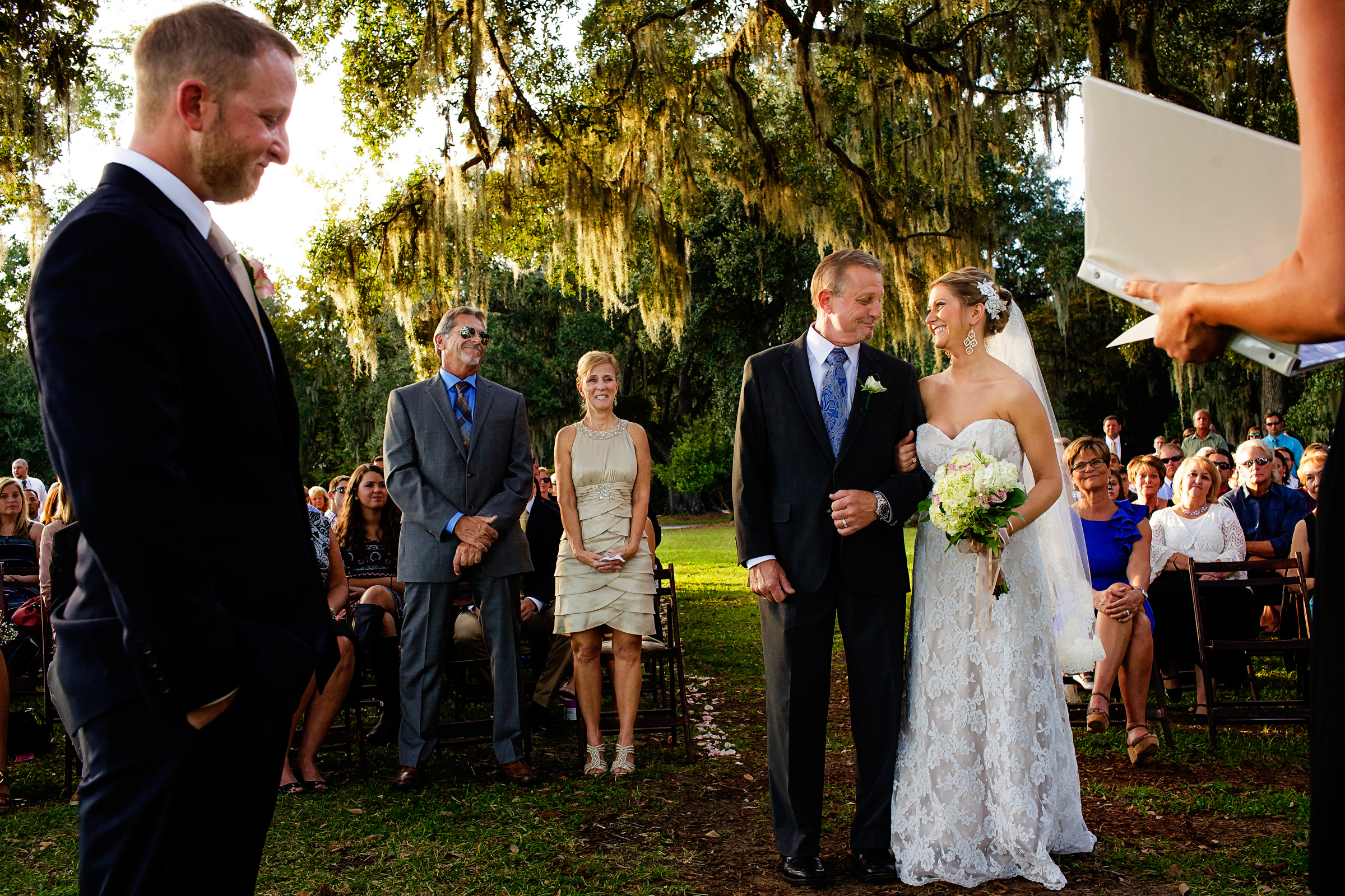 Bride and groom in the outdoor aisle - photo by Chrisman Studios