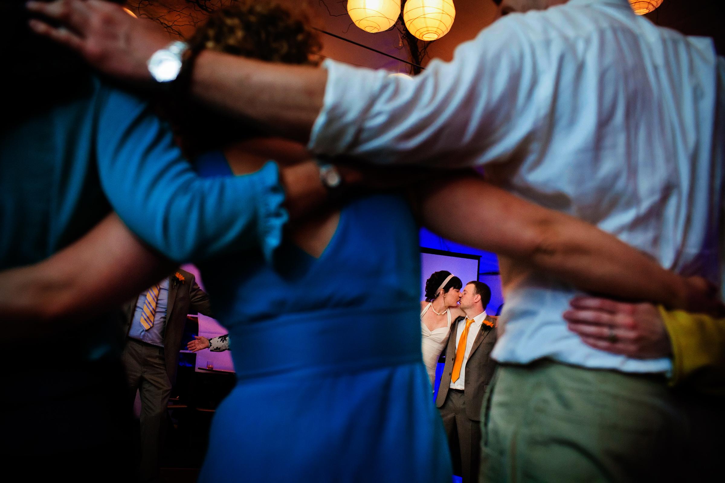 Couple kissing seen through line dance - photo by Chrisman Studios