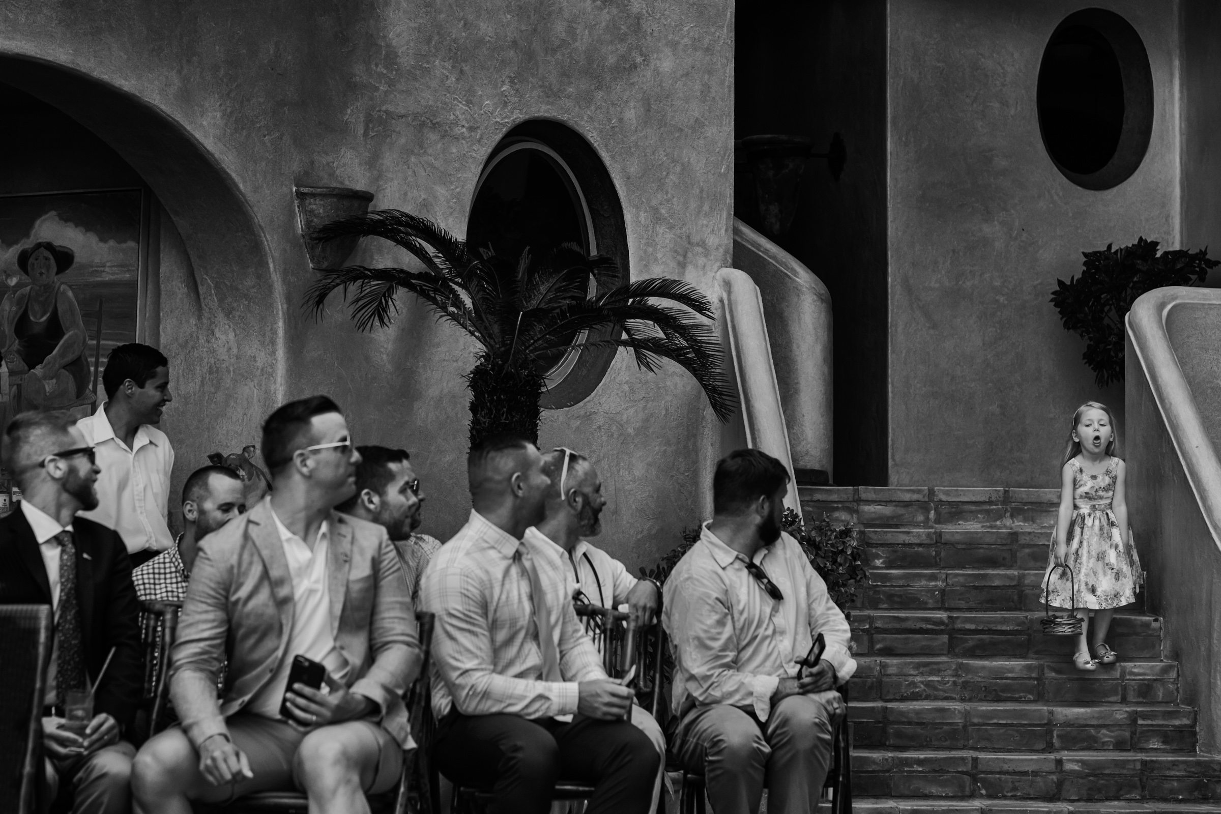 Guests turn to see little girl on stairs - photo by Chrisman Studios