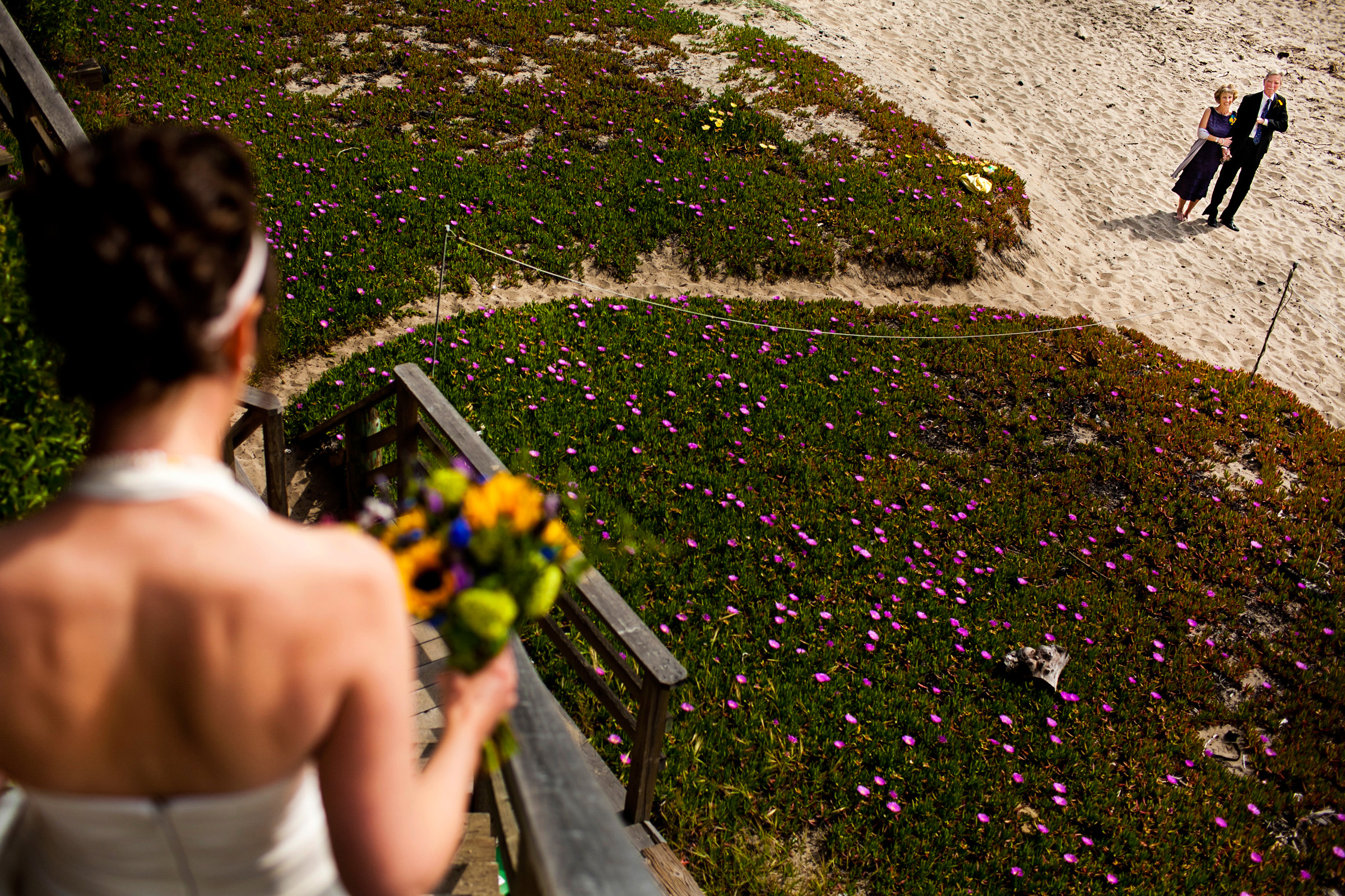 Parents look as bride walk down steps - photo by Chrisman Studios