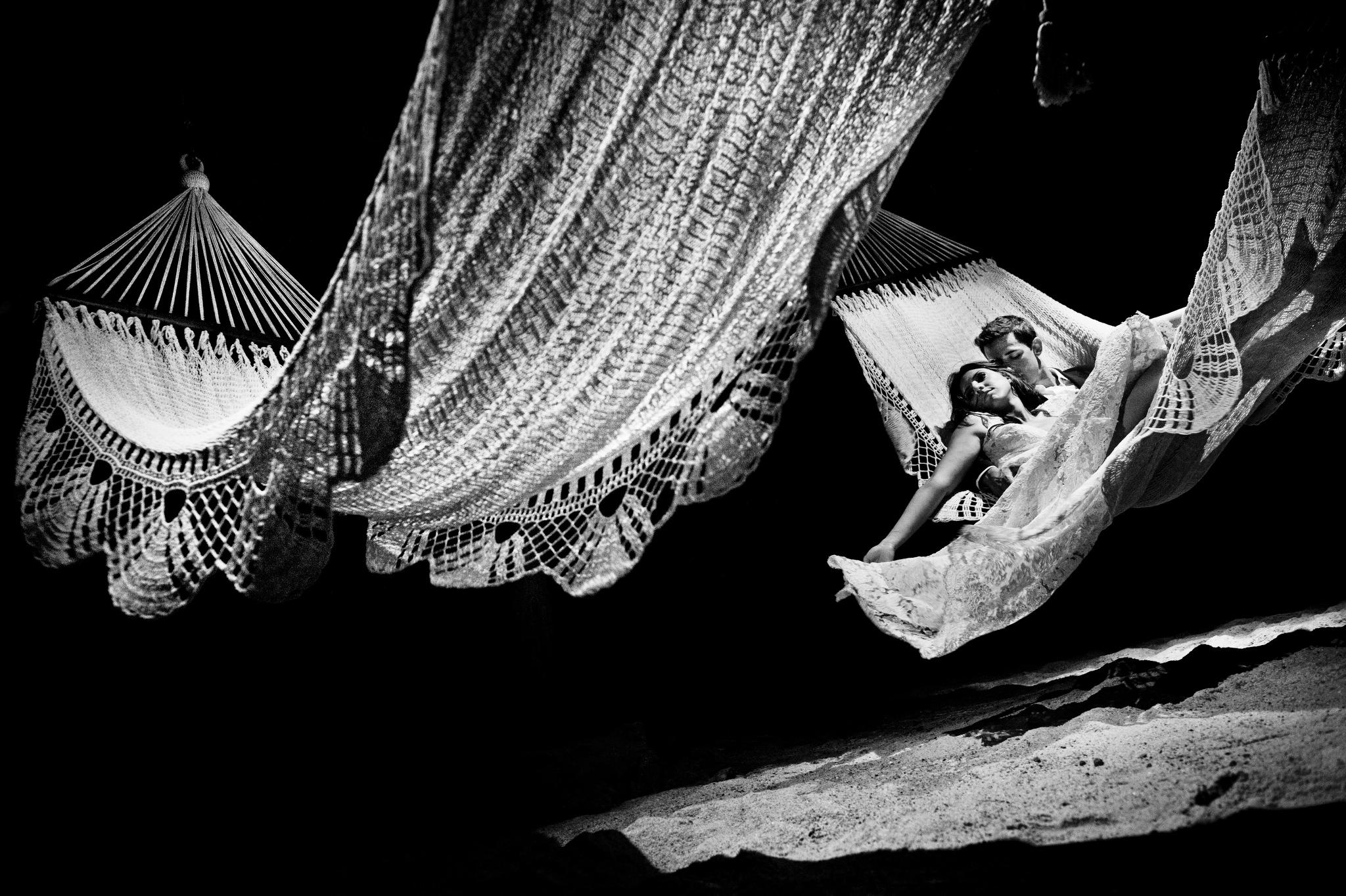 Couple lying in hammock by Ben Chrisman of Chrisman Studios