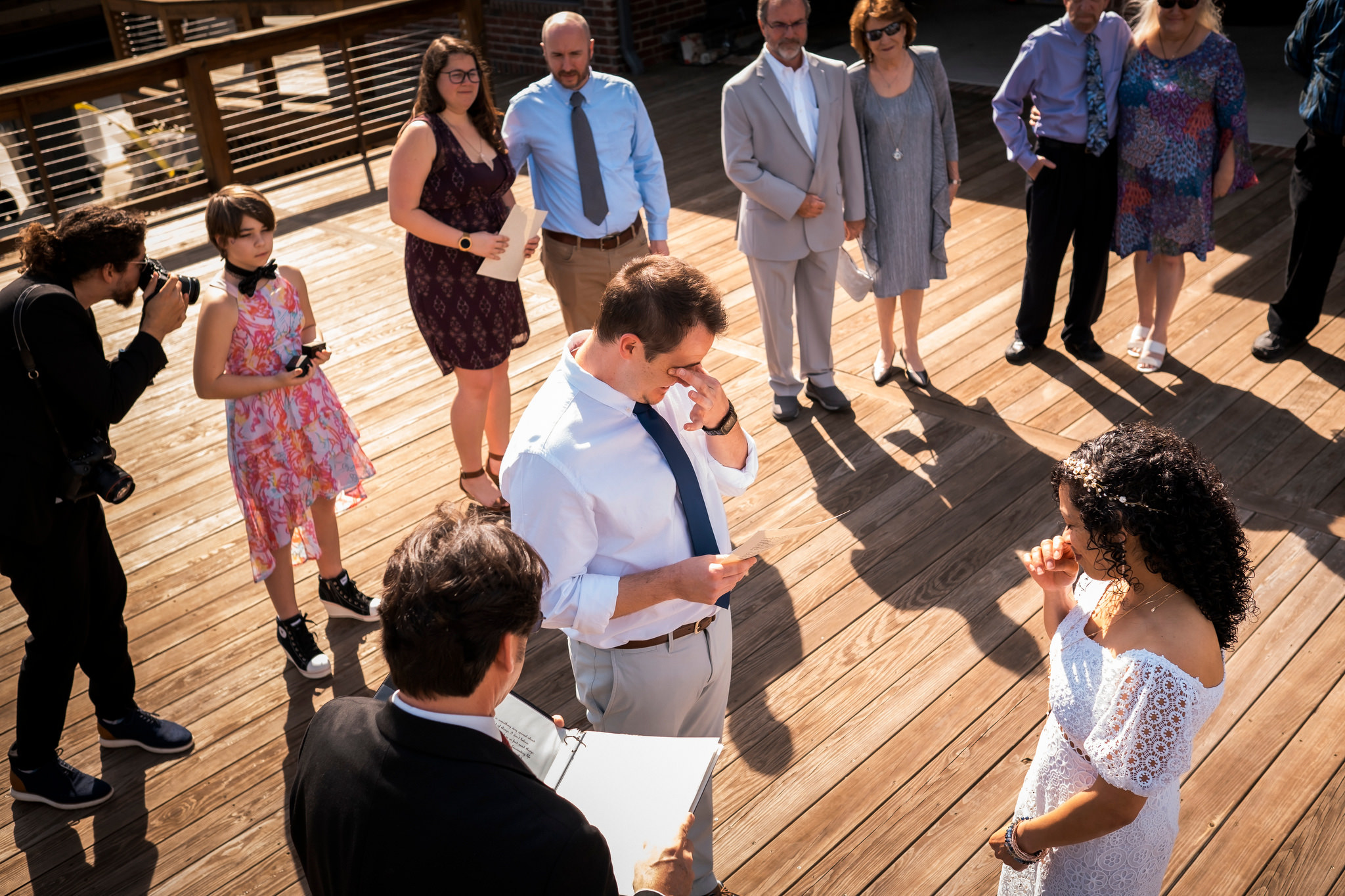 bride and groom exchange vows with lots of emotions- photo by Chrisman Studios, south carolina, lake murray
