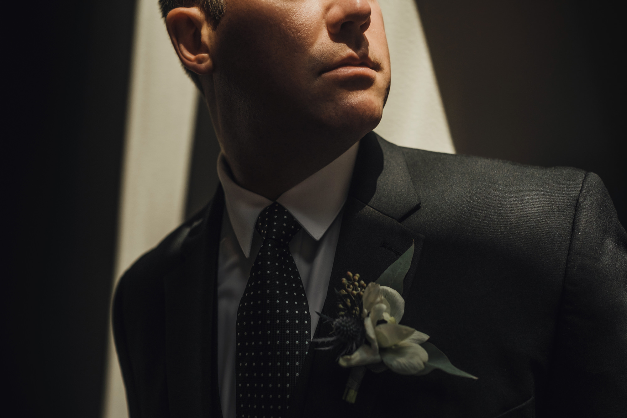 groom close up with boutonniere- photo by Chrisman Studios, charleston, restoration
