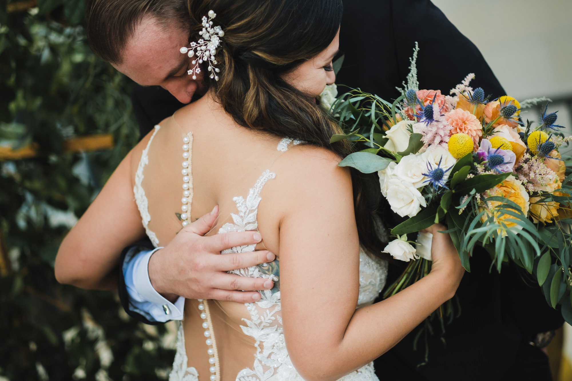 groom hugging his bride in sweet moment- photo by Chrisman Studios, charleston, restoration